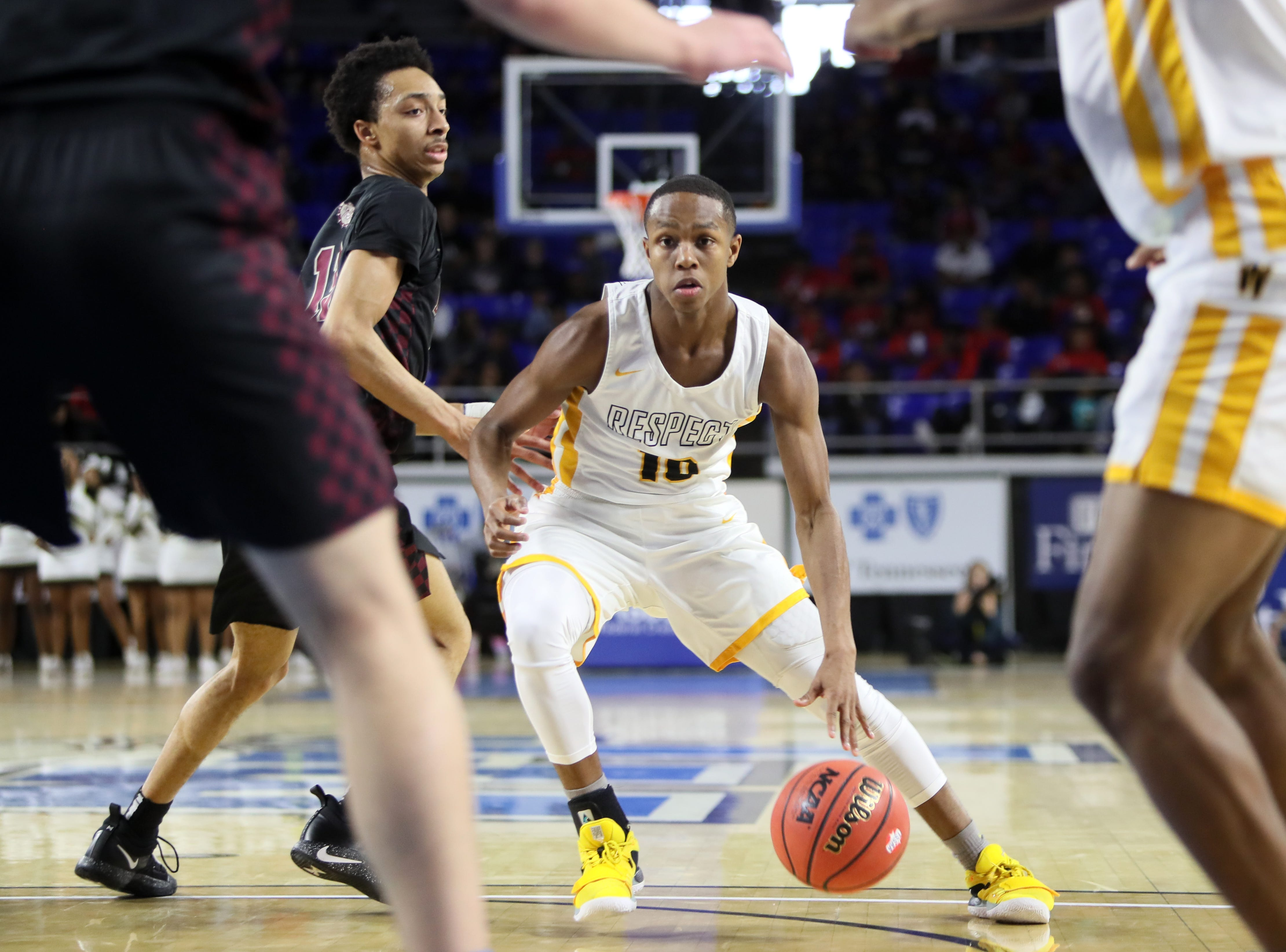 Whitehaven's Antwarn Smith cuts through the defense of Bearden during the Class AAA boys basketball state semifinal at the Murphy Center in Murfreesboro, Tenn. on Thursday, March 14, 2019.