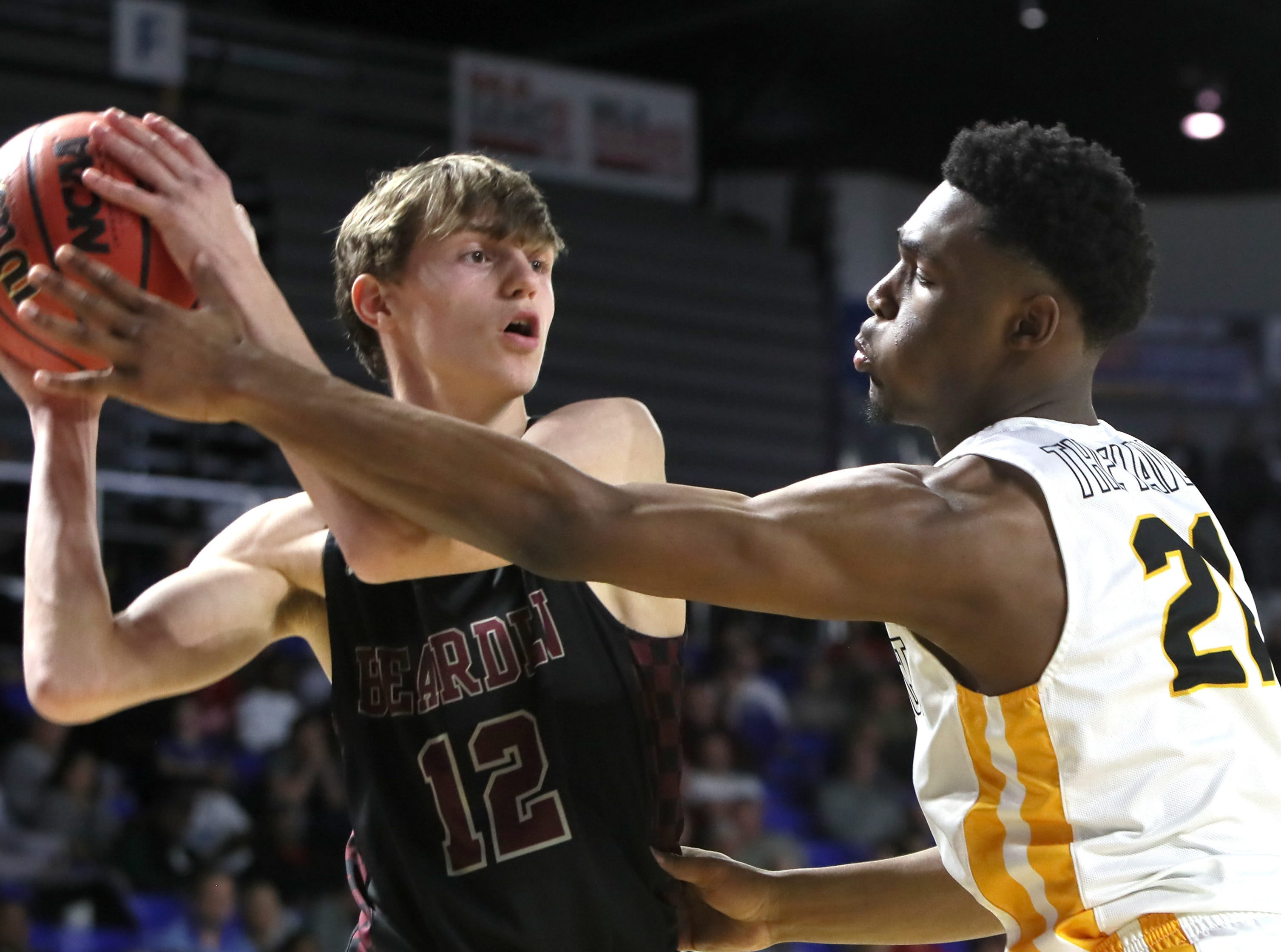 Whitehaven's Devine Owens defends Bearden's Hayden Treadwell during the Class AAA boys basketball state semifinal at the Murphy Center in Murfreesboro, Tenn. on Friday, March 15, 2019.
