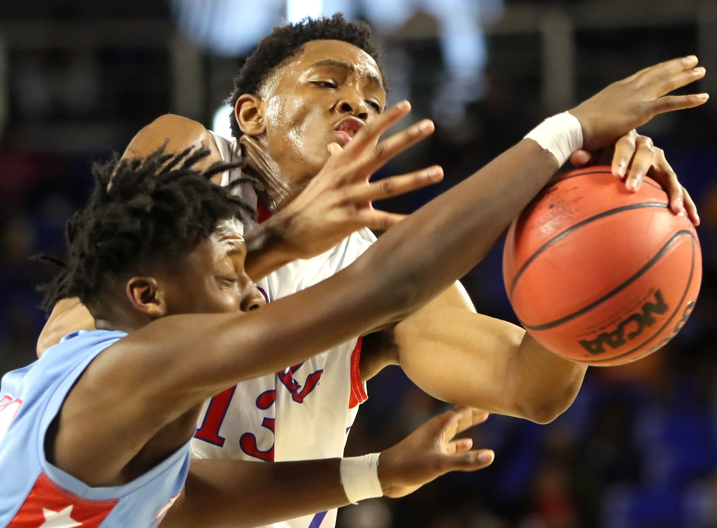 Wooddale's Chandler Lawson is stripped by Brainerd's Ciante Chaney during the Class AA boys basketball state semifinal at the Murphy Center in Murfreesboro, Tenn. on Thursday, March 14, 2019.