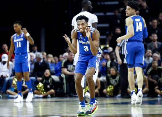Memphis guard Jeremiah Martin (middle) celebrates during a 79-55 victory over UCF in their quarterfinal round AAC Tournament game at the  FedExForum, Friday, March 15, 2019.