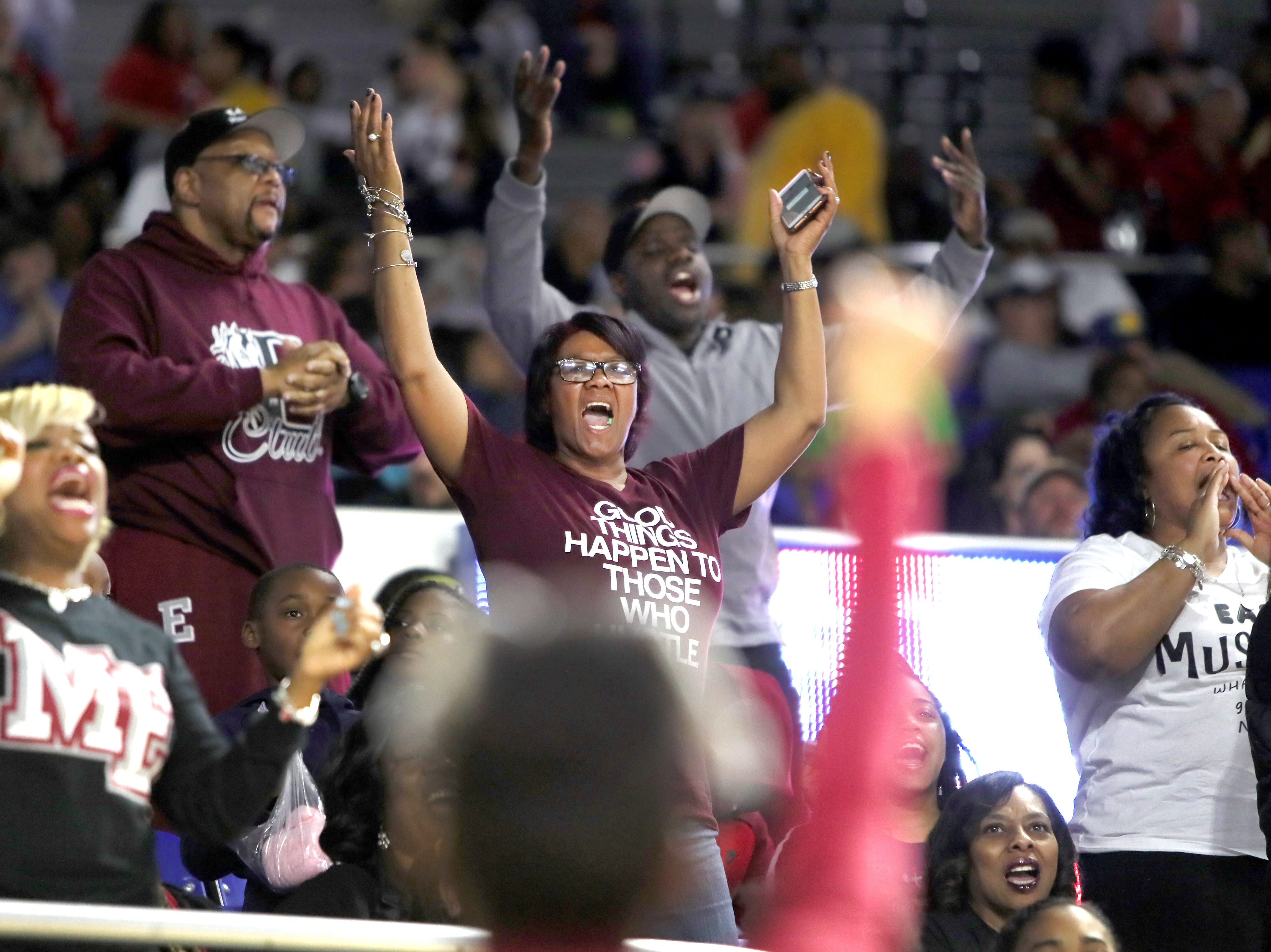 Memphis East fans celebrate as their team defeats Brentwood during the Class AAA boys basketball state semifinal at the Murphy Center in Murfreesboro, Tenn. on Friday, March 15, 2019.