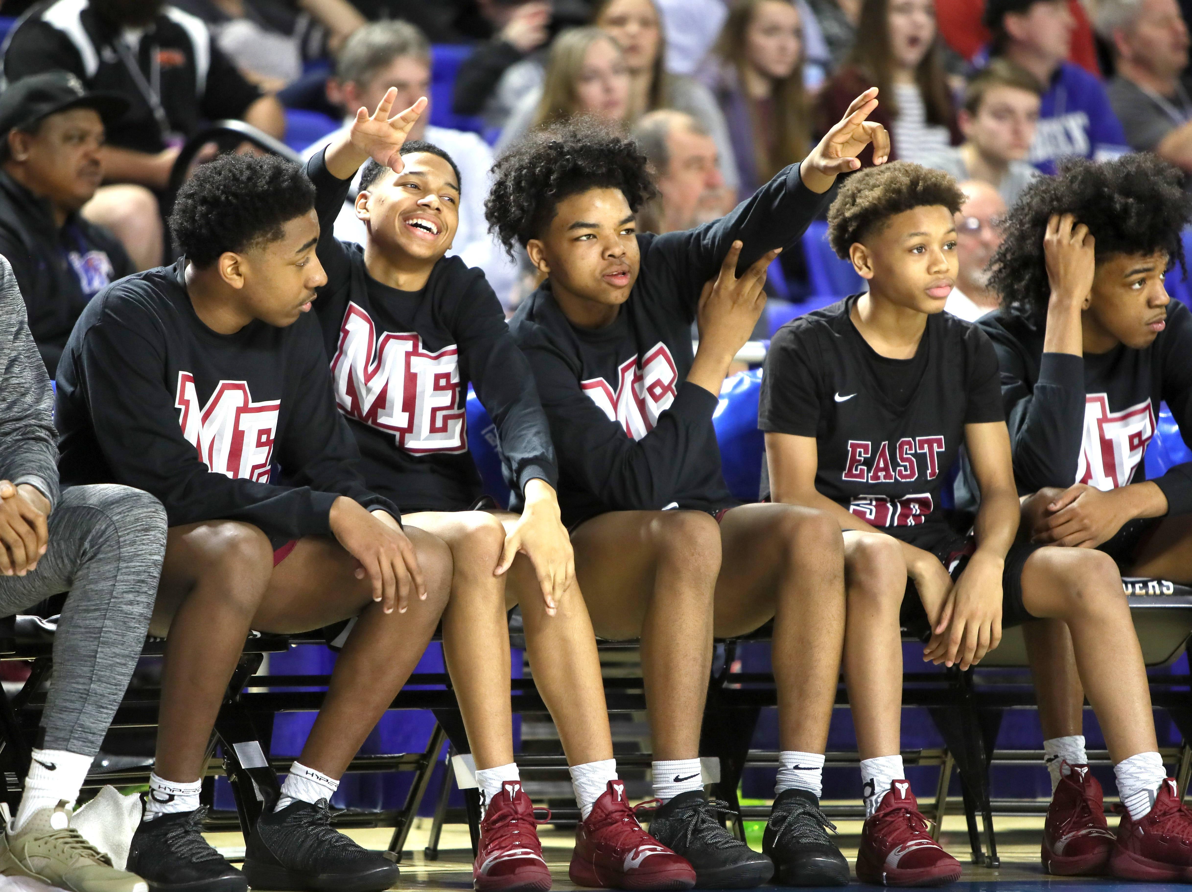 Memphis East players cheer on their teammates as they defeat Brentwood 46-42 during the Class AAA boys basketball state semifinal at the Murphy Center in Murfreesboro, Tenn. on Friday, March 15, 2019.