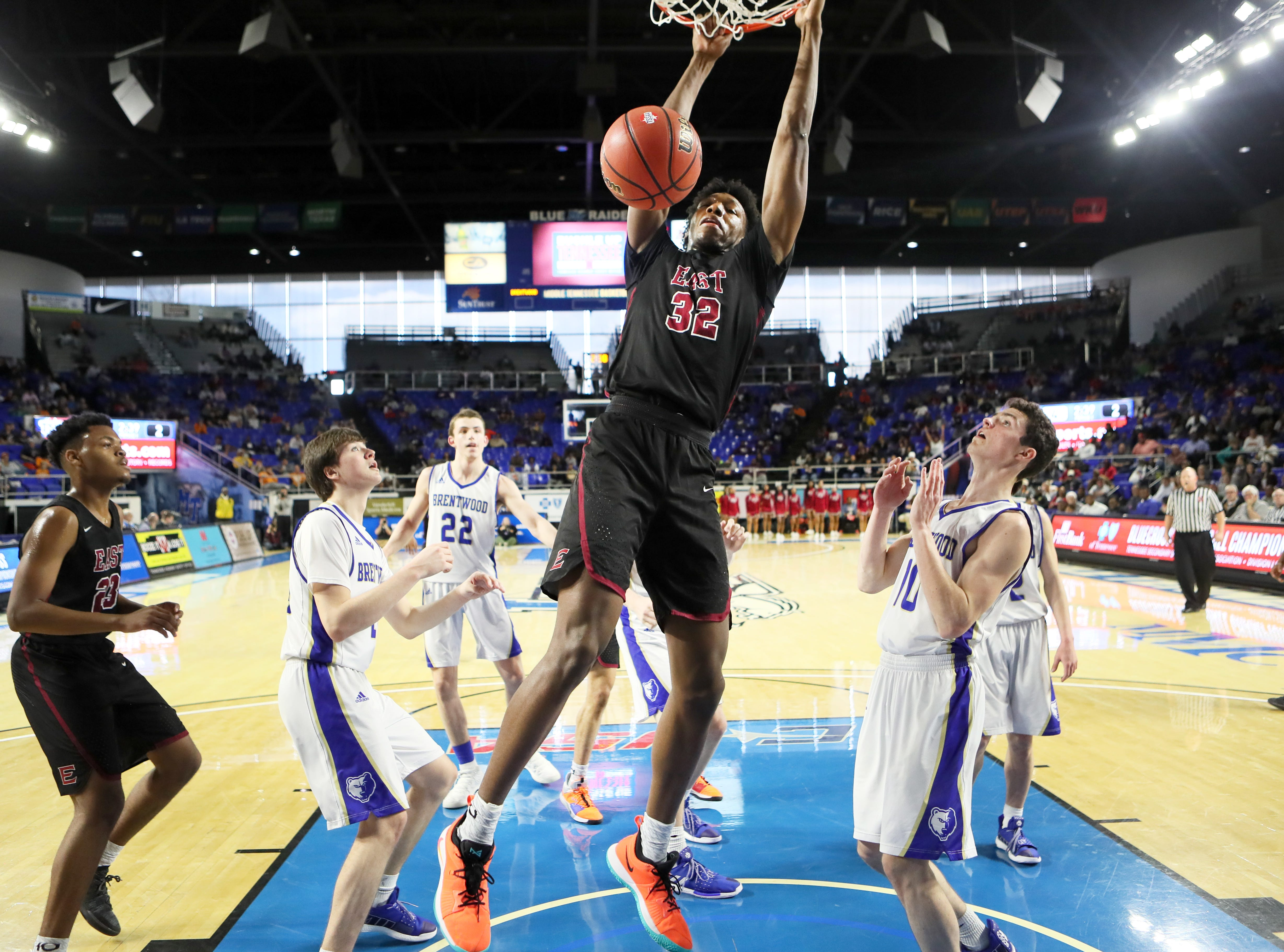Memphis East's James Wiseman dunk the ball against Brentwood during the Class AAA boys basketball state semifinal at the Murphy Center in Murfreesboro, Tenn. on Thursday, March 14, 2019.