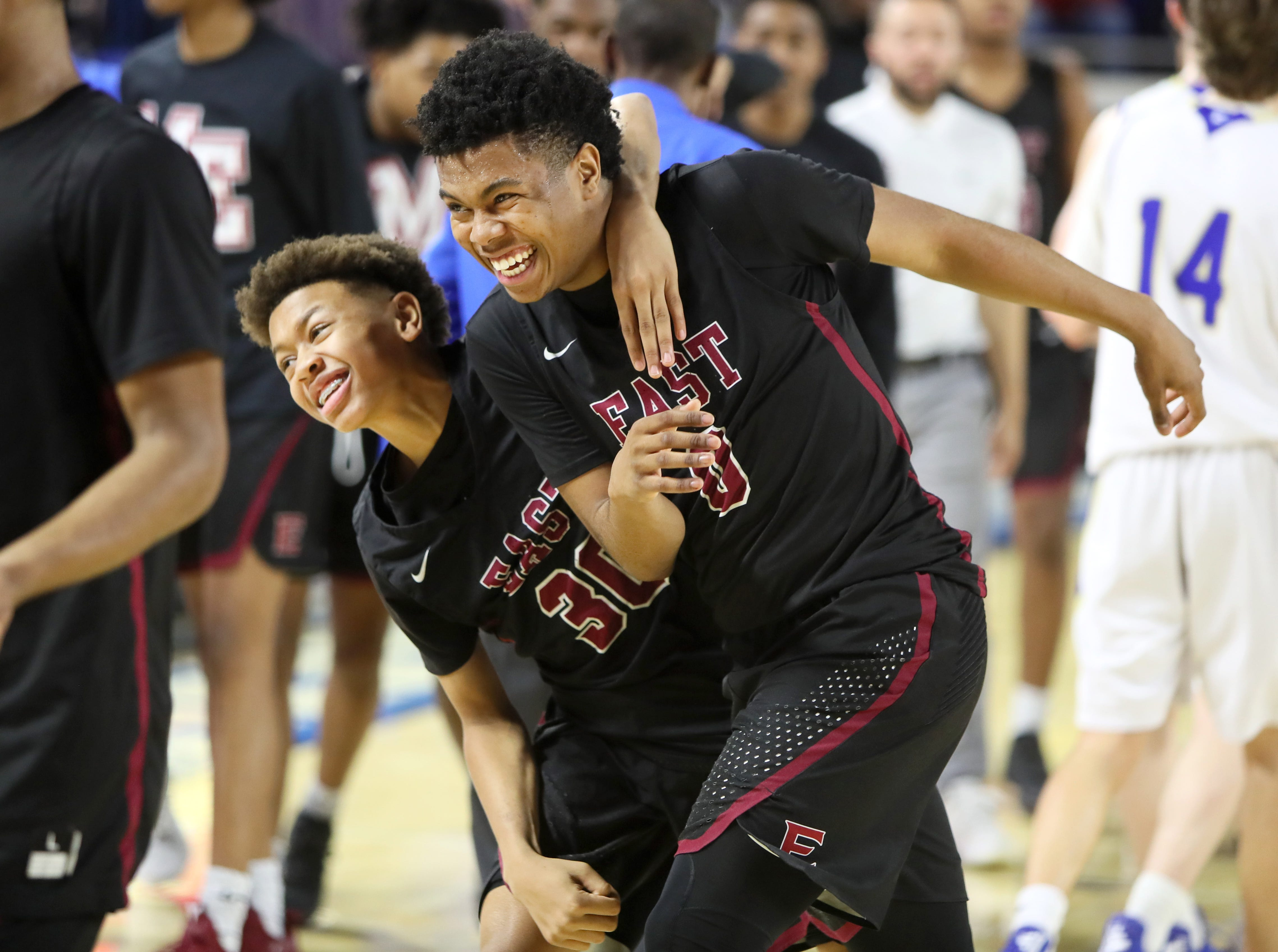 Memphis East's Terrence Jacobs, left, and Derrein Merriweather celebrate their 46-42 win over Brentwood during the Class AAA boys basketball state semifinal at the Murphy Center in Murfreesboro, Tenn. on Friday, March 15, 2019.
