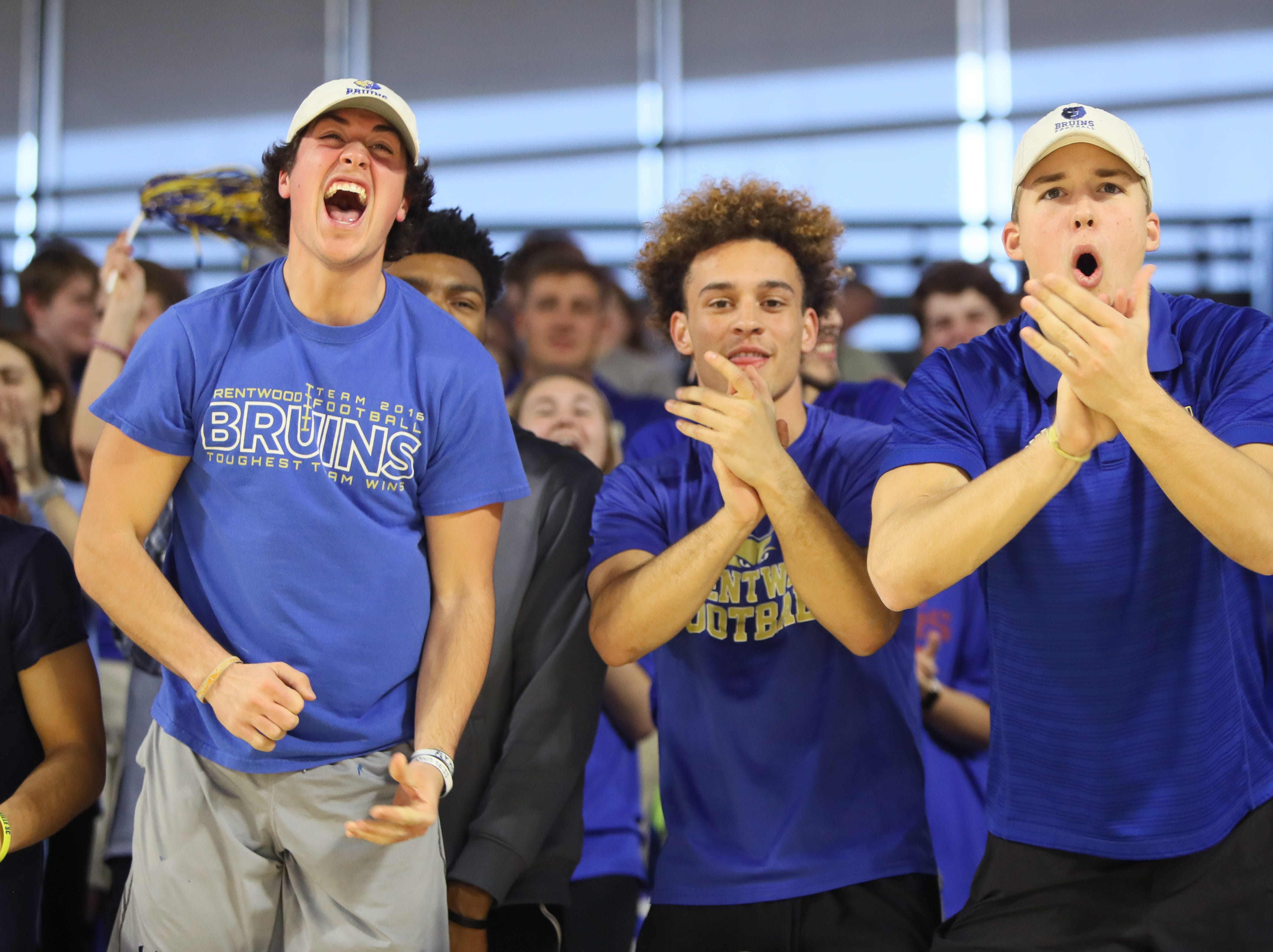 Brentwood fans cheer on their team against Memphis East during the Class AAA boys basketball state semifinal at the Murphy Center in Murfreesboro, Tenn. on Thursday, March 14, 2019.