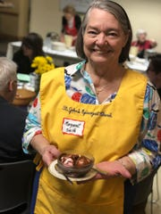 Margaret Smith has been a volunteer server at Calvary Episcopal Church's annual Waffle Shop for 46 years.