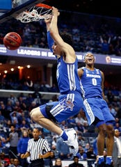 Memphis forward Kyvon Davenport (right) celebrates as teammate Isaiah Maurice (left) dunks over the UCF defense during action in their quarterfinal round AAC Tournament game at the  FedExForum, Friday, March 15, 2019.