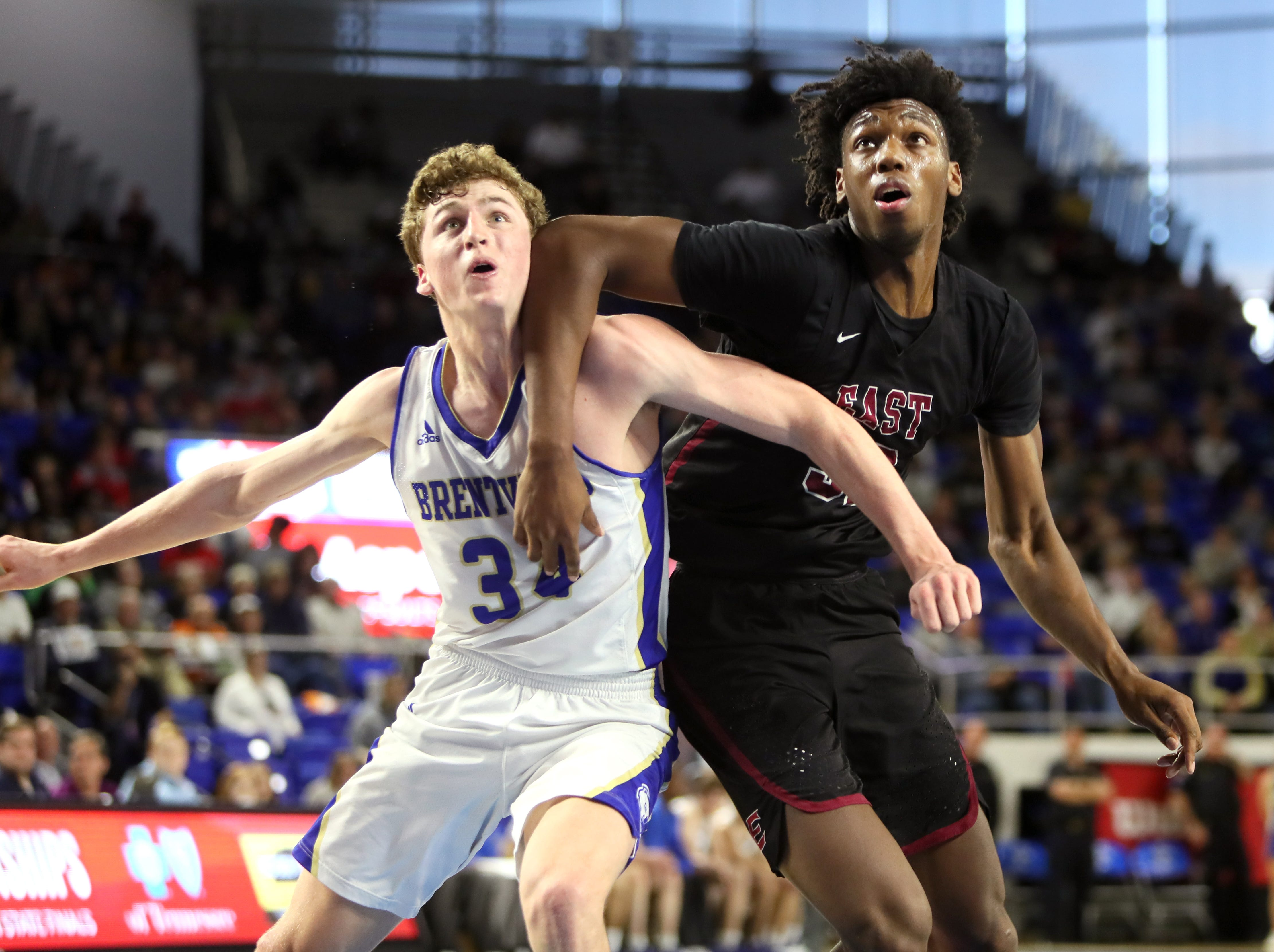 Memphis East's James Wiseman battles for position with Brentwood's Ben Mills during the Class AAA boys basketball state semifinal at the Murphy Center in Murfreesboro, Tenn. on Friday, March 15, 2019.