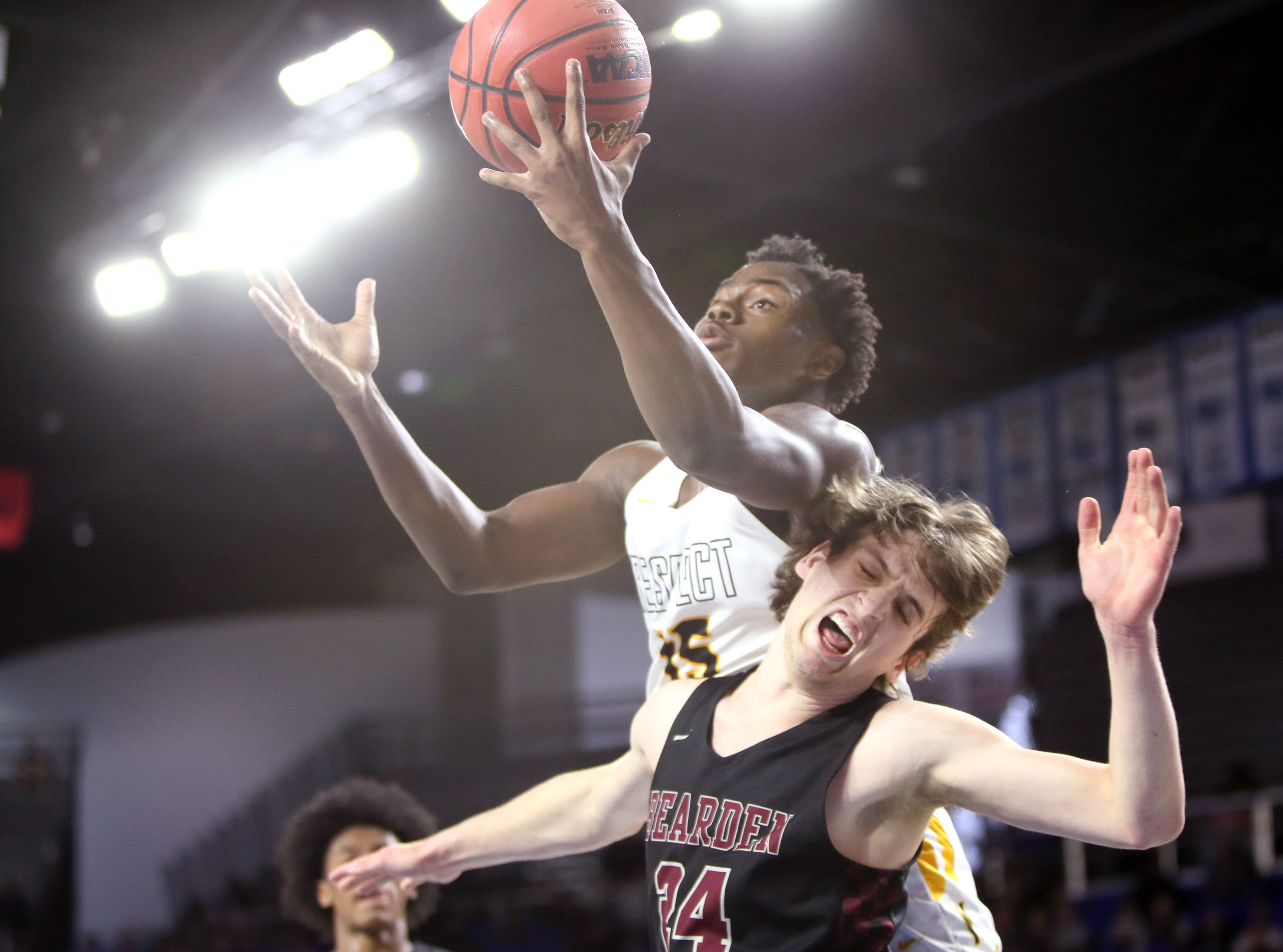 Whitehaven's Keveon Mullins grabs a rebound over Bearden's Kordell Kah during the Class AAA boys basketball state semifinal at the Murphy Center in Murfreesboro, Tenn. on Thursday, March 14, 2019.
