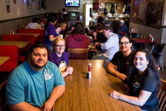 From left, Andrew Ishee, Molly Ishee, Adrian Ishee, and Dewana Ishee at Broadway Pizza's original location on Broad Avenue. The Ishees own and operate Broadway Pizza's two locations in Memphis.