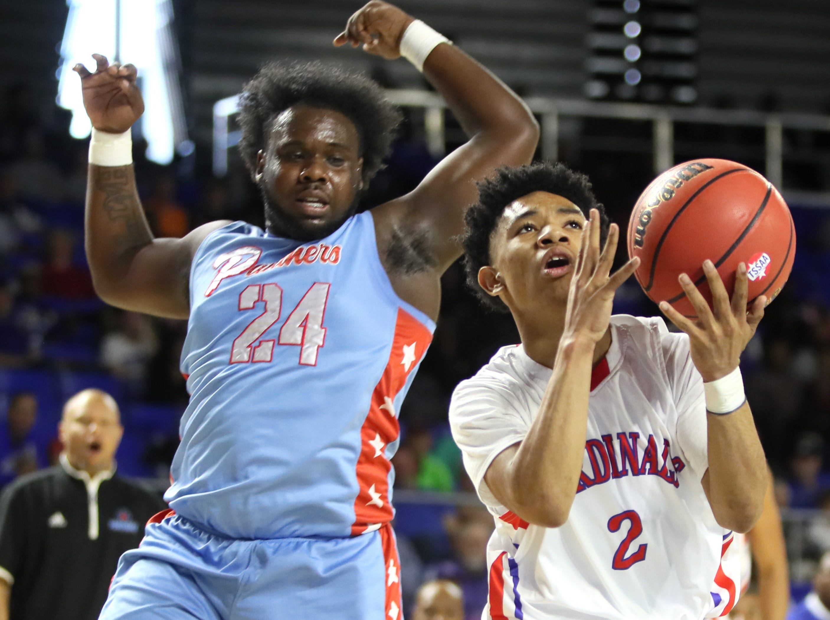 Wooddale's Kevin Brown drives past Brainerd's Ciante Chaney during the Class AA boys basketball state semifinal at the Murphy Center in Murfreesboro, Tenn. on Thursday, March 14, 2019.