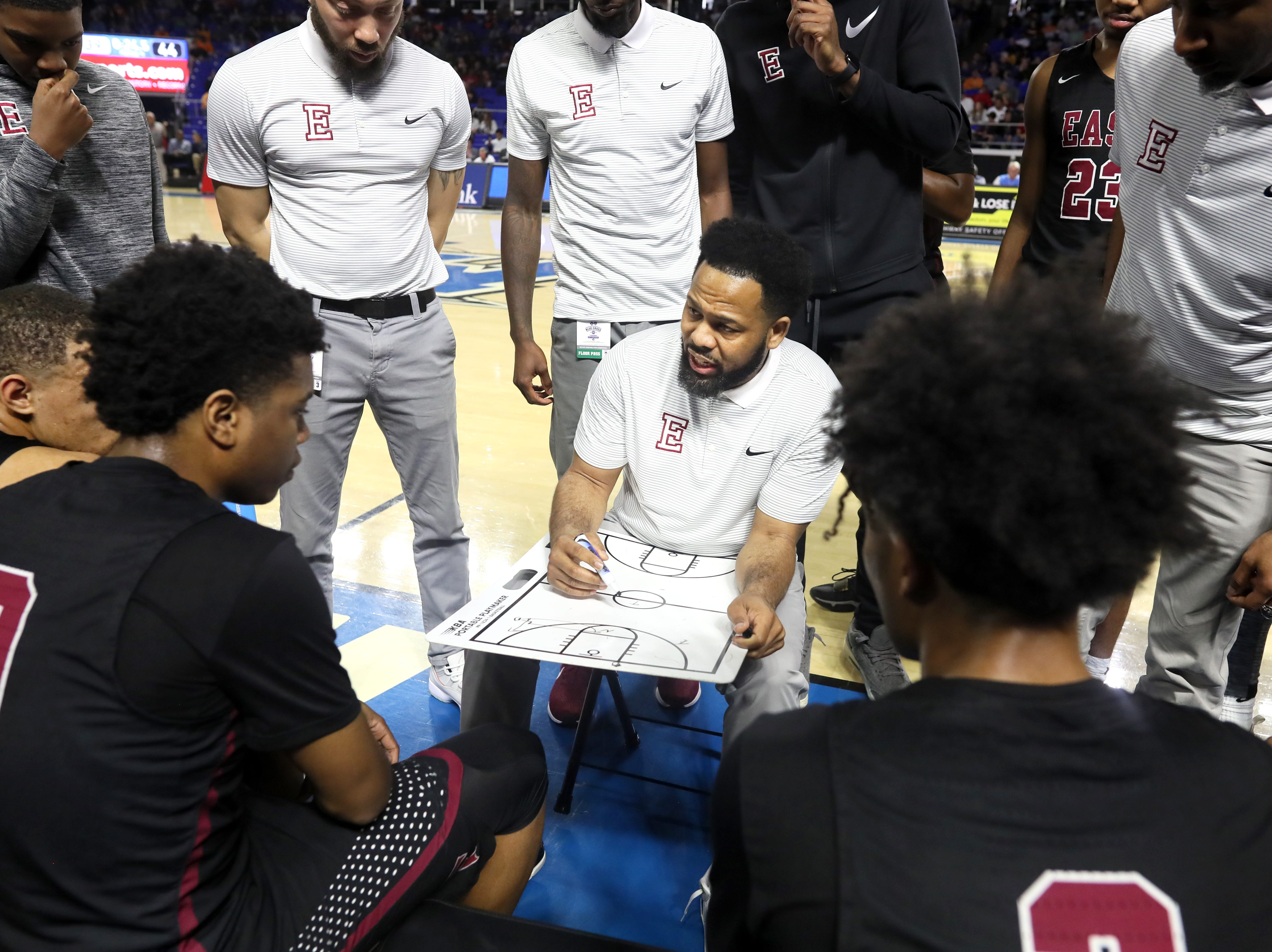 Memphis East Head Coach Jevonte Holmes talks to his team during a timeout in their game against Brentwood in the Class AAA boys basketball state semifinal at the Murphy Center in Murfreesboro, Tenn. on Friday, March 15, 2019.