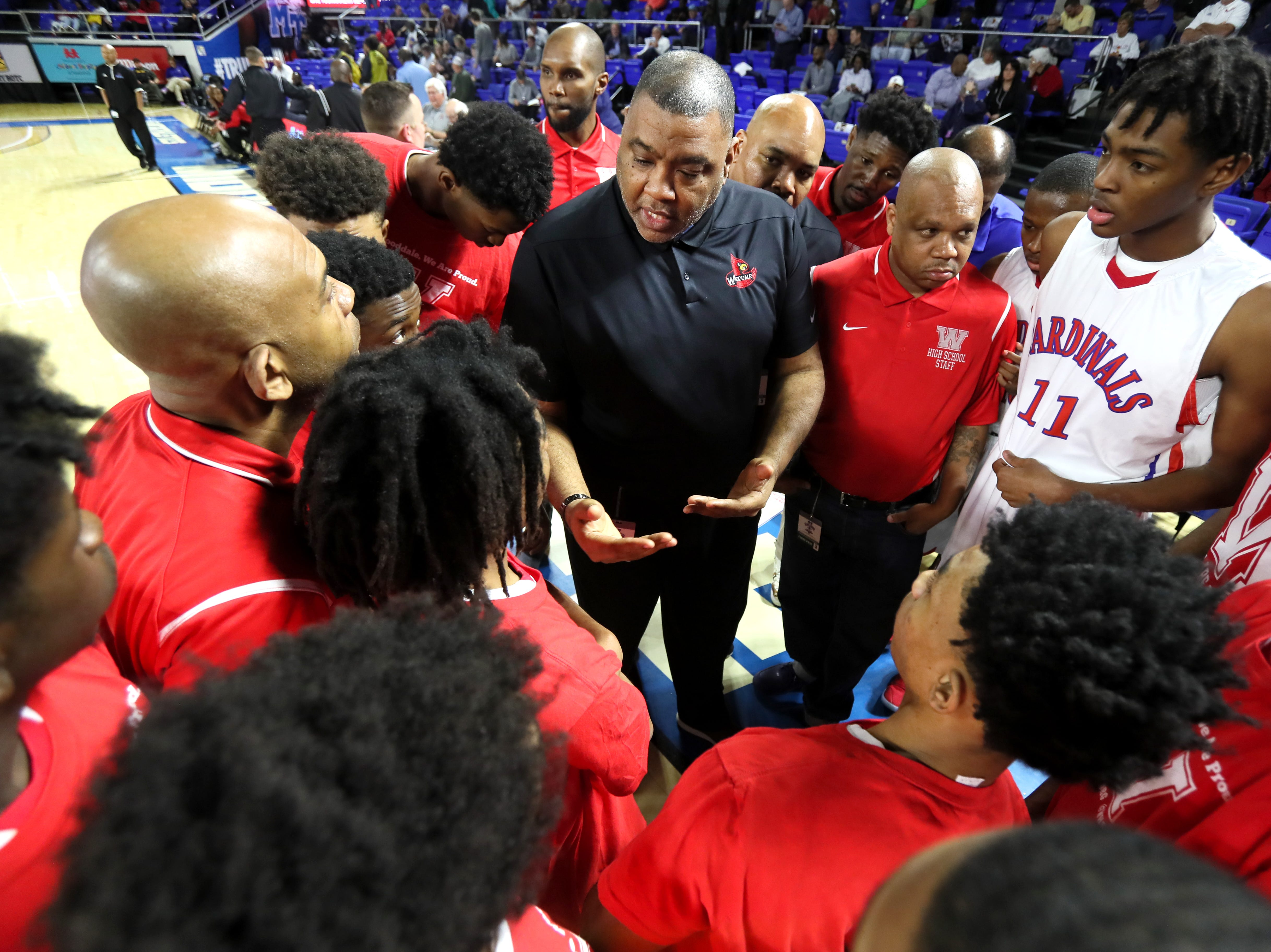 Wooddale Head Coach Keelon Lawson talks to his team before they take on Brainerd during the Class AA boys basketball state semifinal at the Murphy Center in Murfreesboro, Tenn. on Thursday, March 14, 2019.