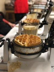 Waffles are made fresh to order at Calvary Episcopal Church's annual Waffle Shop during Lent.
