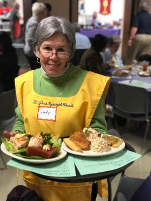 Volunteers from area churches, like Judy Deshaies pictured here, serve and prepare the food at The Waffle Shop at Calvary Episcopal Church. The Waffle Shop is open only during Lent, from Tuesday through Friday.