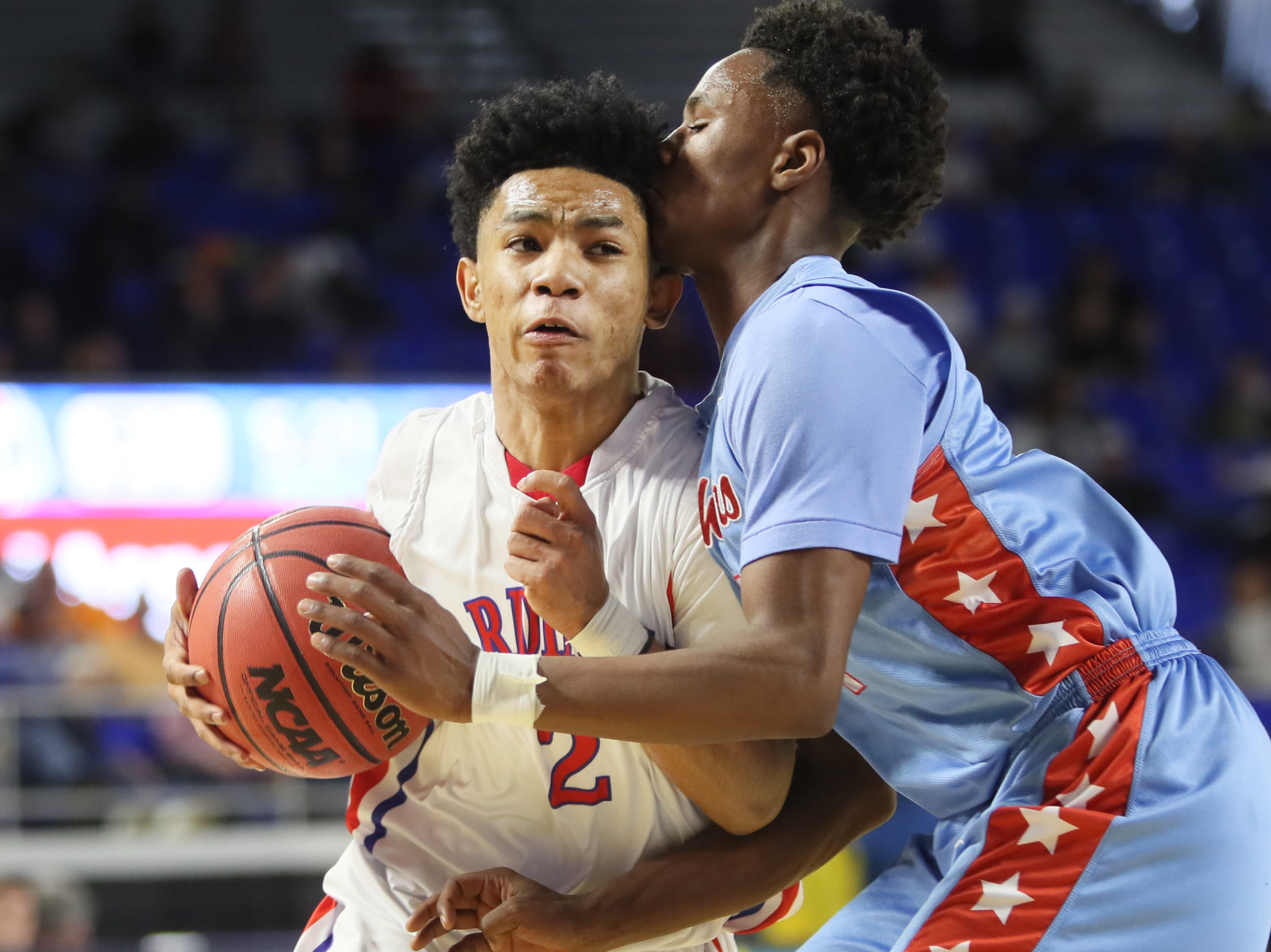 Wooddale's Kevin Brown drives past Brainerd's Remeo Hubbard during the Class AA boys basketball state semifinal at the Murphy Center in Murfreesboro, Tenn. on Thursday, March 14, 2019.