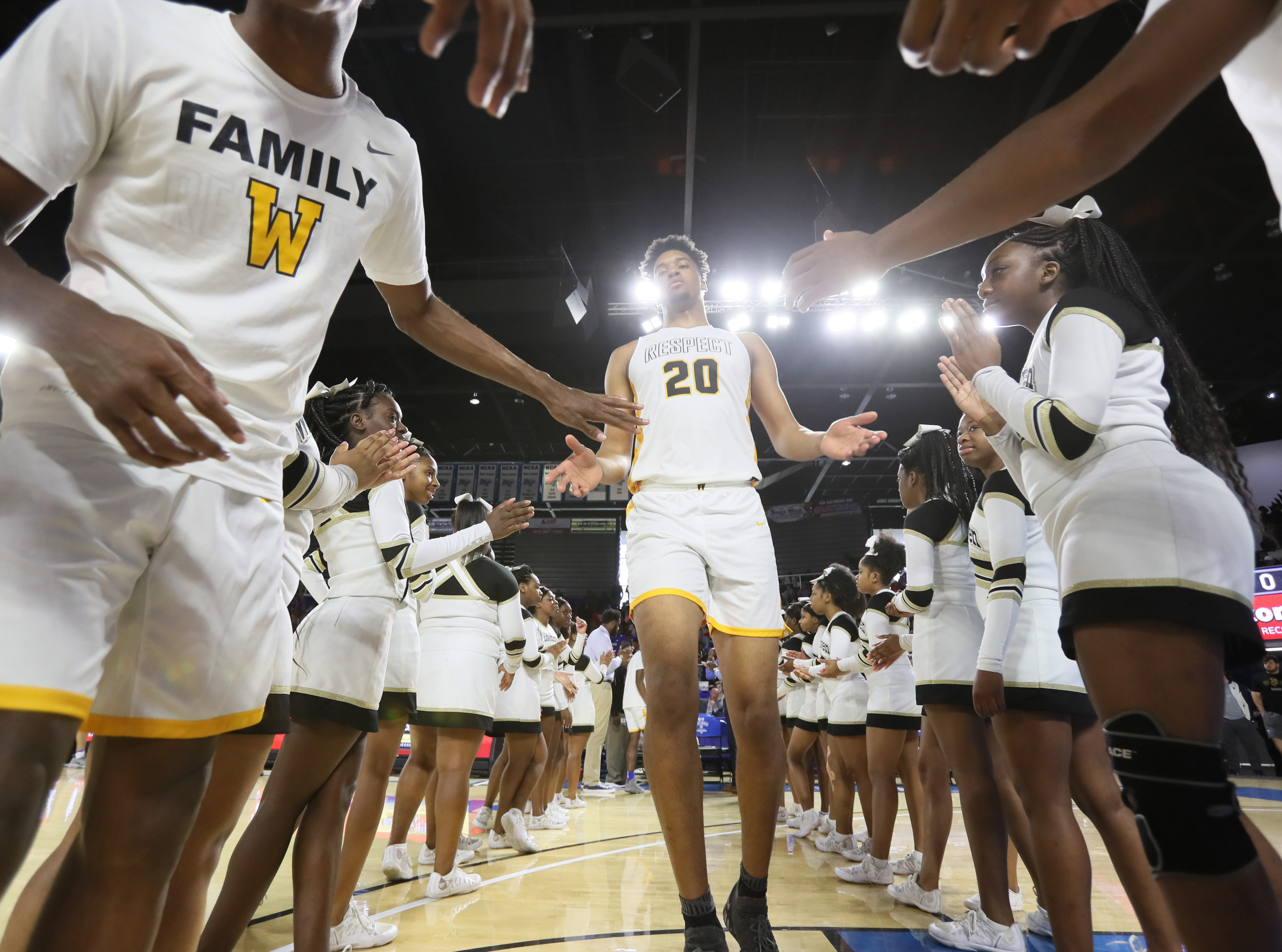 Whitehaven's Jordan Wilmore is introduced before they take on Bearden during the Class AAA boys basketball state semifinal at the Murphy Center in Murfreesboro, Tenn. on Friday, March 15, 2019.