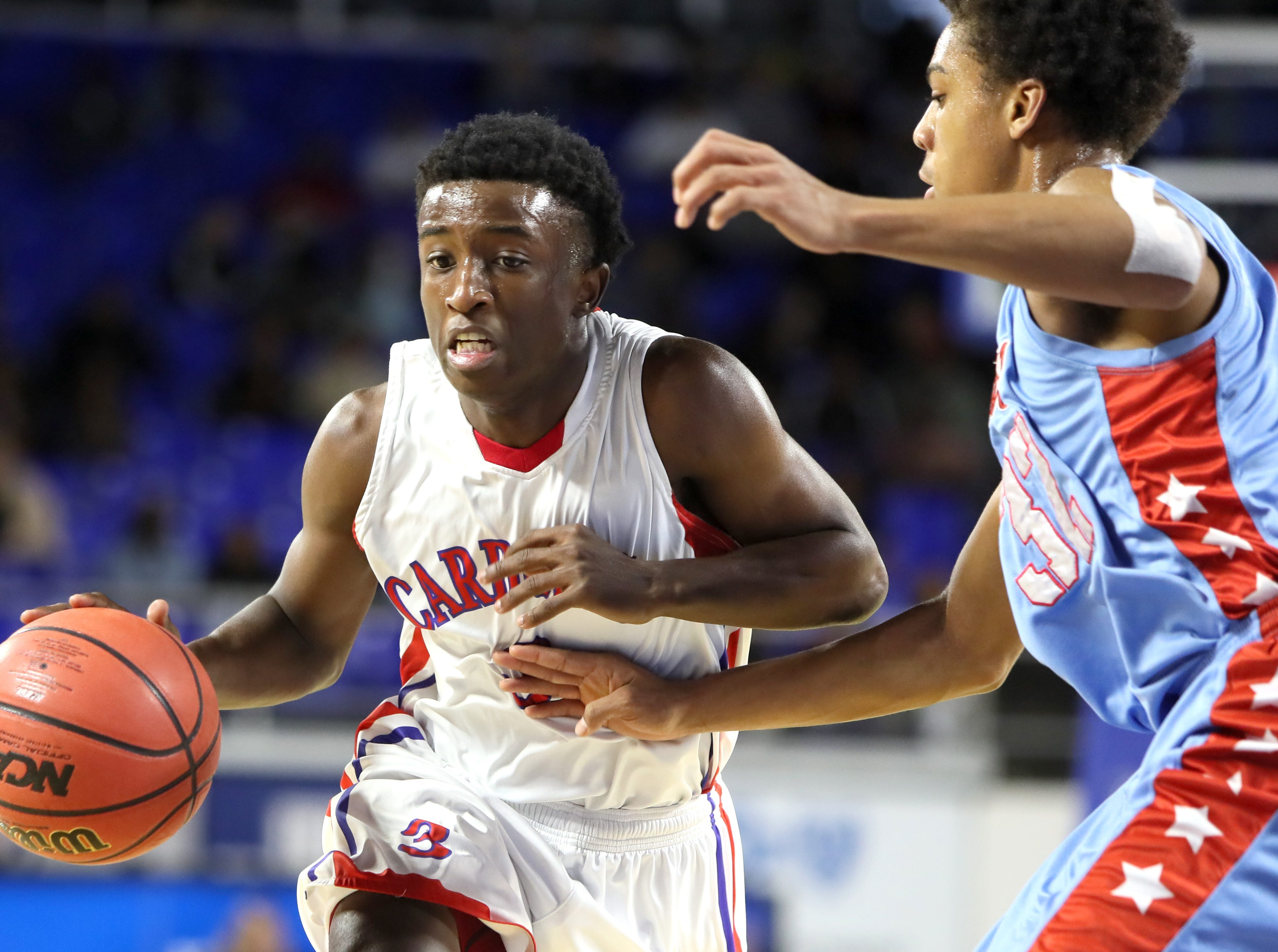 Wooddale's Alvin Miles drives past Brainerd's Cameron Evans during the Class AA boys basketball state semifinal at the Murphy Center in Murfreesboro, Tenn. on Thursday, March 14, 2019.