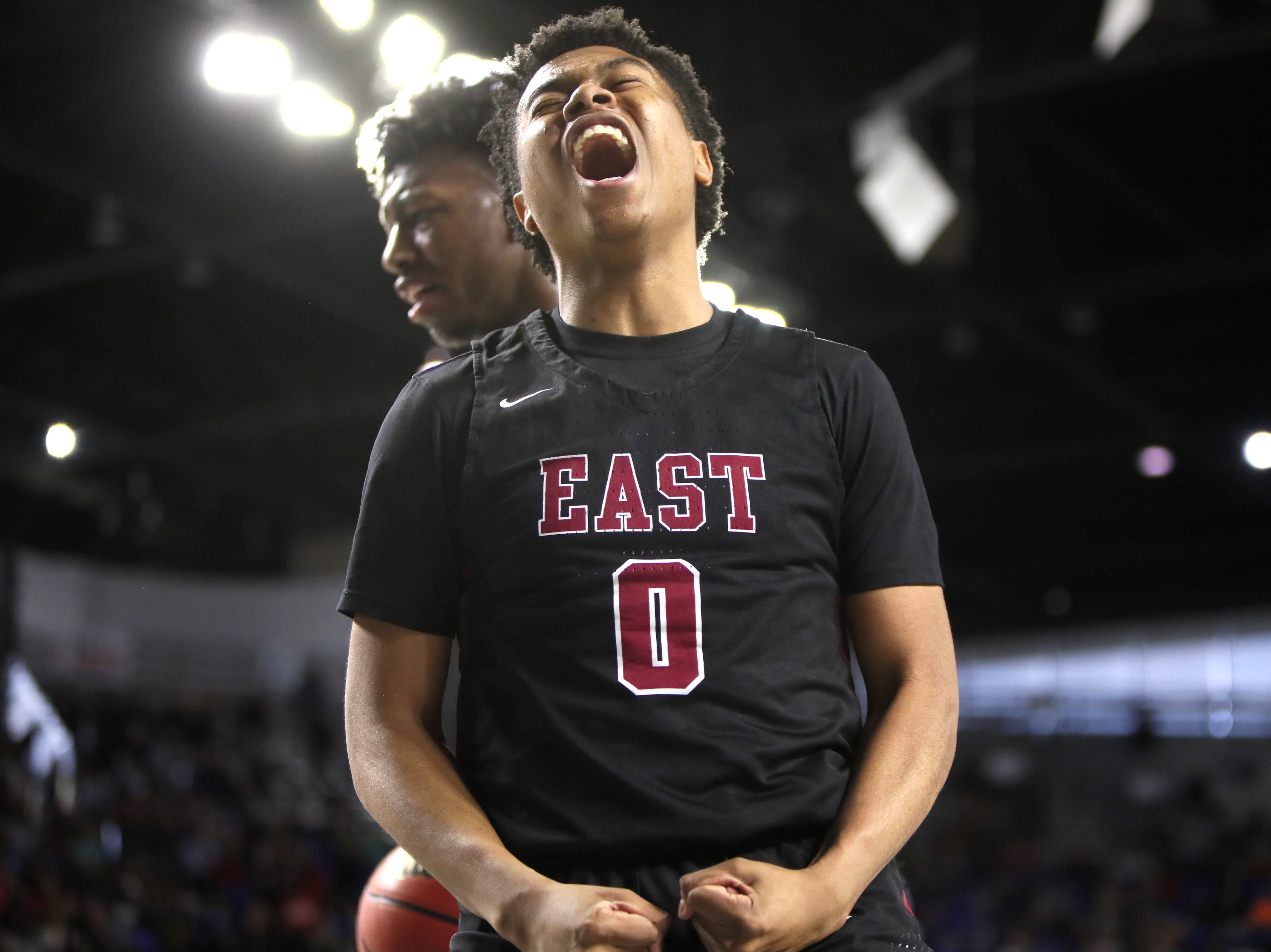 Memphis East's Derrein Merriweather celebrates his teammate's layup as they go on to defeat Brentwood 46-42 during the Class AAA boys basketball state semifinal at the Murphy Center in Murfreesboro, Tenn. on Friday, March 15, 2019.