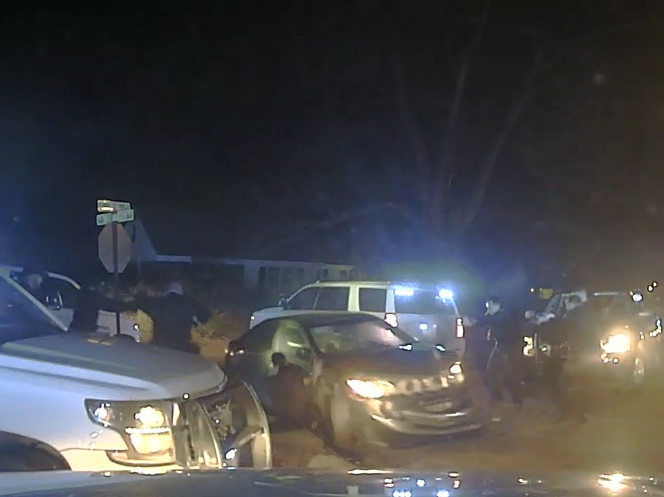 Still frames taken from a dashcam of a West Memphis Police Department vehicle that shows the fatal shooting of Megan Rivera and Deangelo Brown on Jan. 16, 2019.