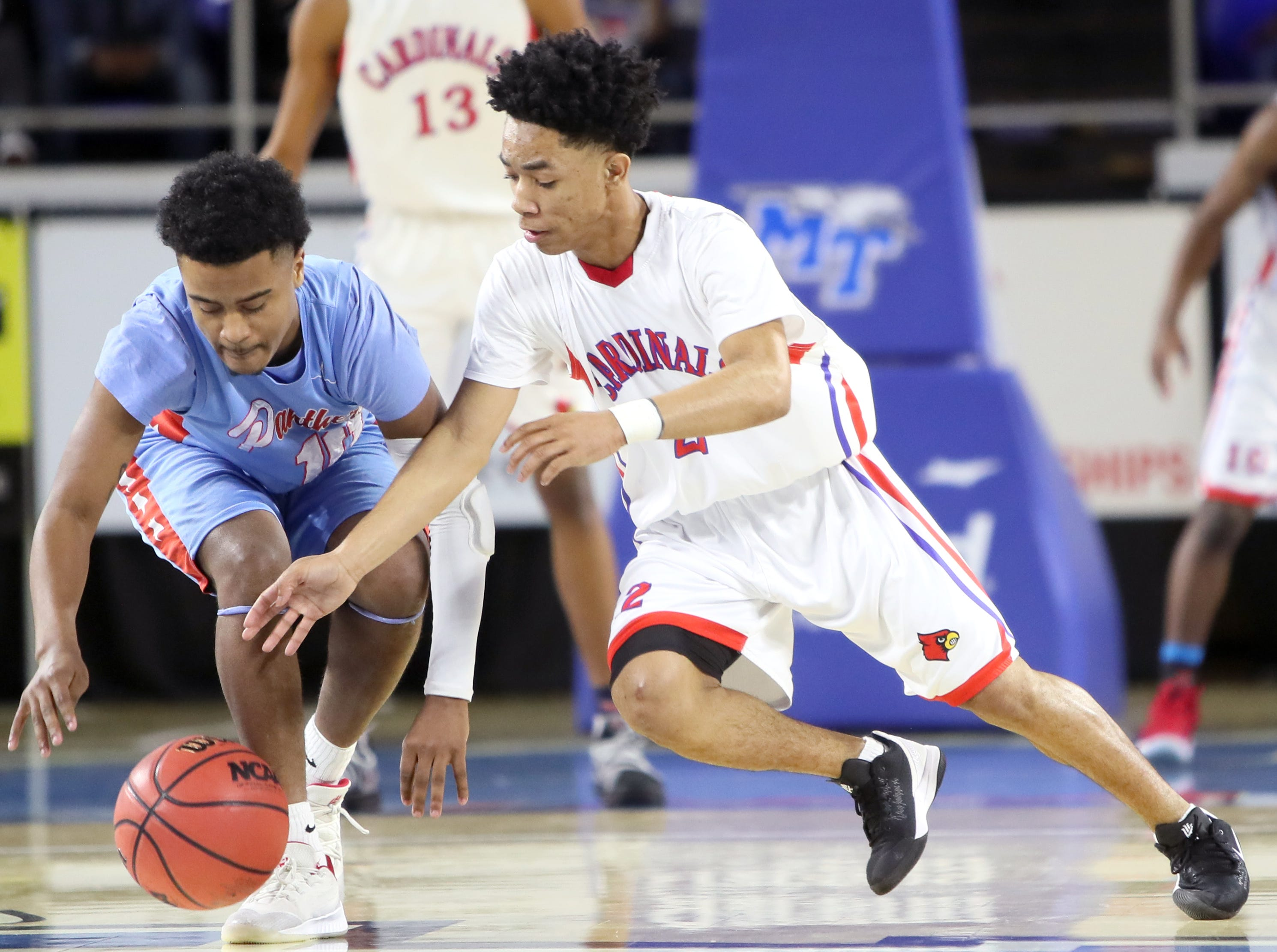 Wooddale's Kevin Brown tries to steal the ball from Brainerd's Kevin Halfacre during the Class AA boys basketball state semifinal at the Murphy Center in Murfreesboro, Tenn. on Thursday, March 14, 2019.