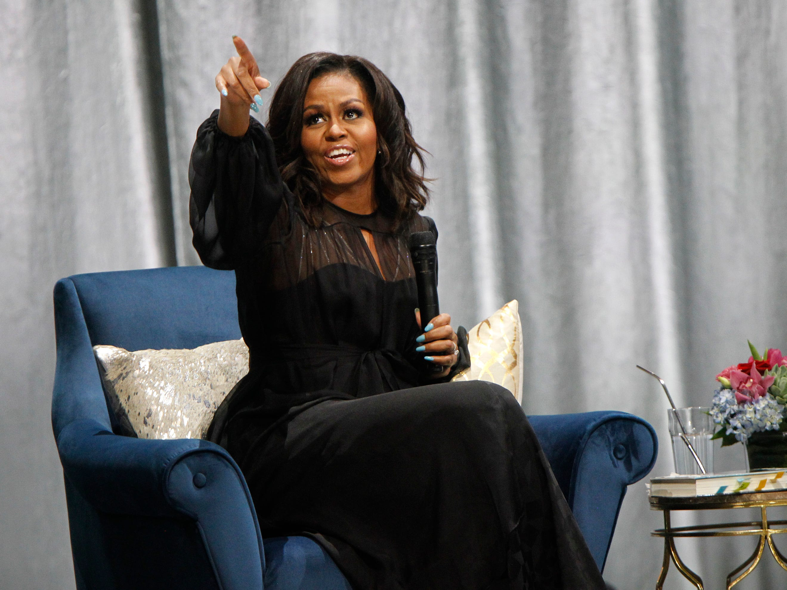 "Former first lady Michelle Obama acknowledges an  audience member during her  ""Becoming: A Conversation with Michelle Obama""  at the Miller High Life Theatre."