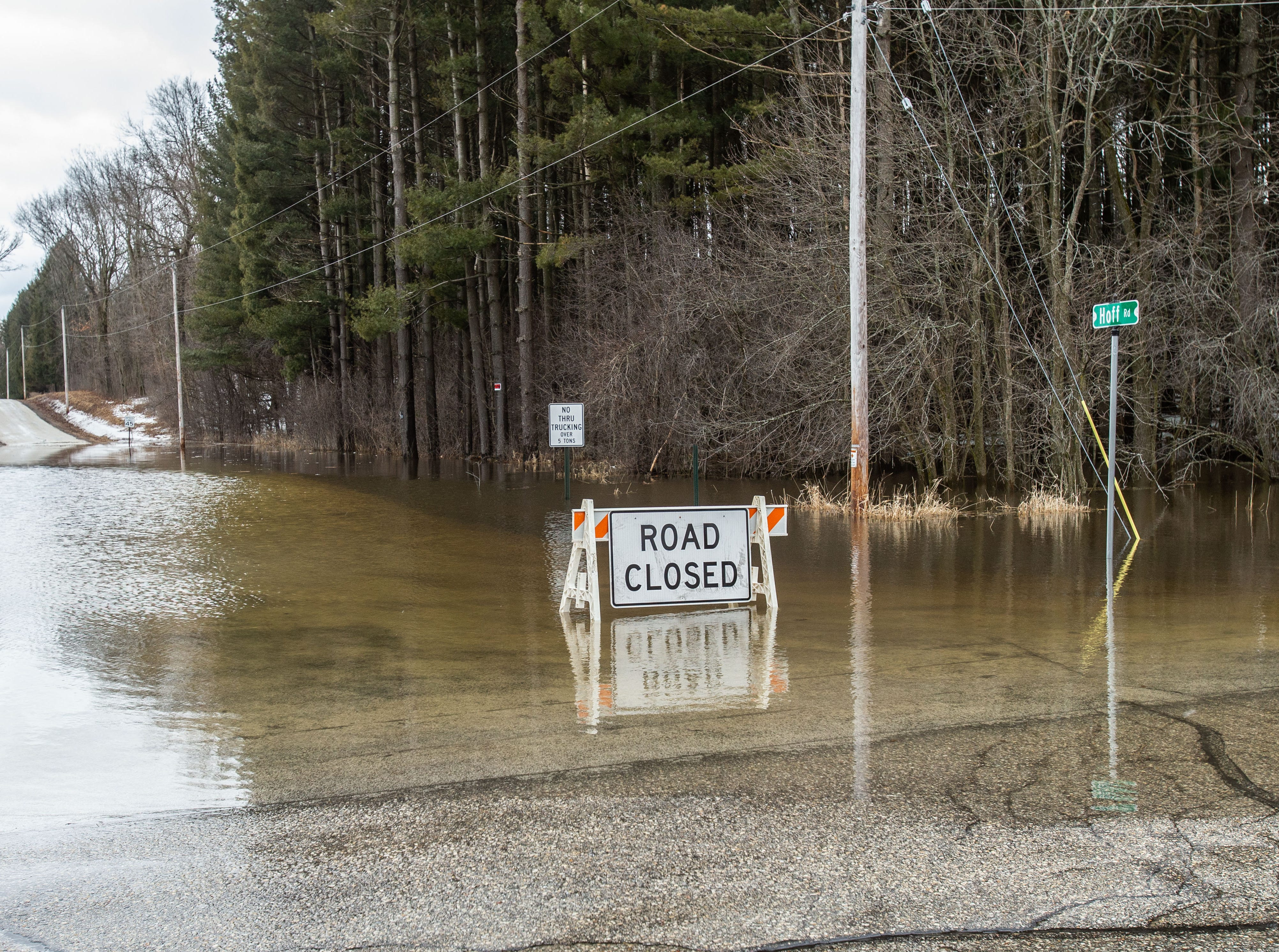 Hoff Road in Hartland is closed due to flood water at County Line Road on Friday, March 15, 2019. Spring-like temperatures caused flooding across both Washington and Waukesha counties.