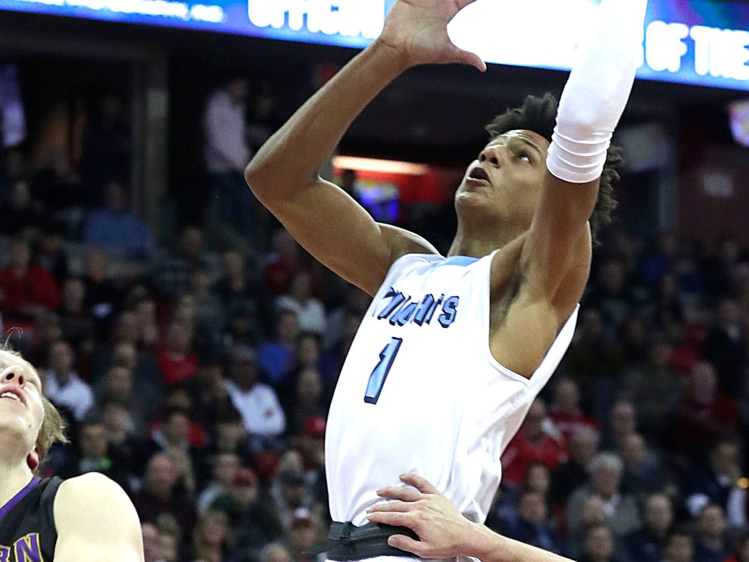 Nicolet's Jalen Johnson creates space at the basket and scores Friday afternoon.