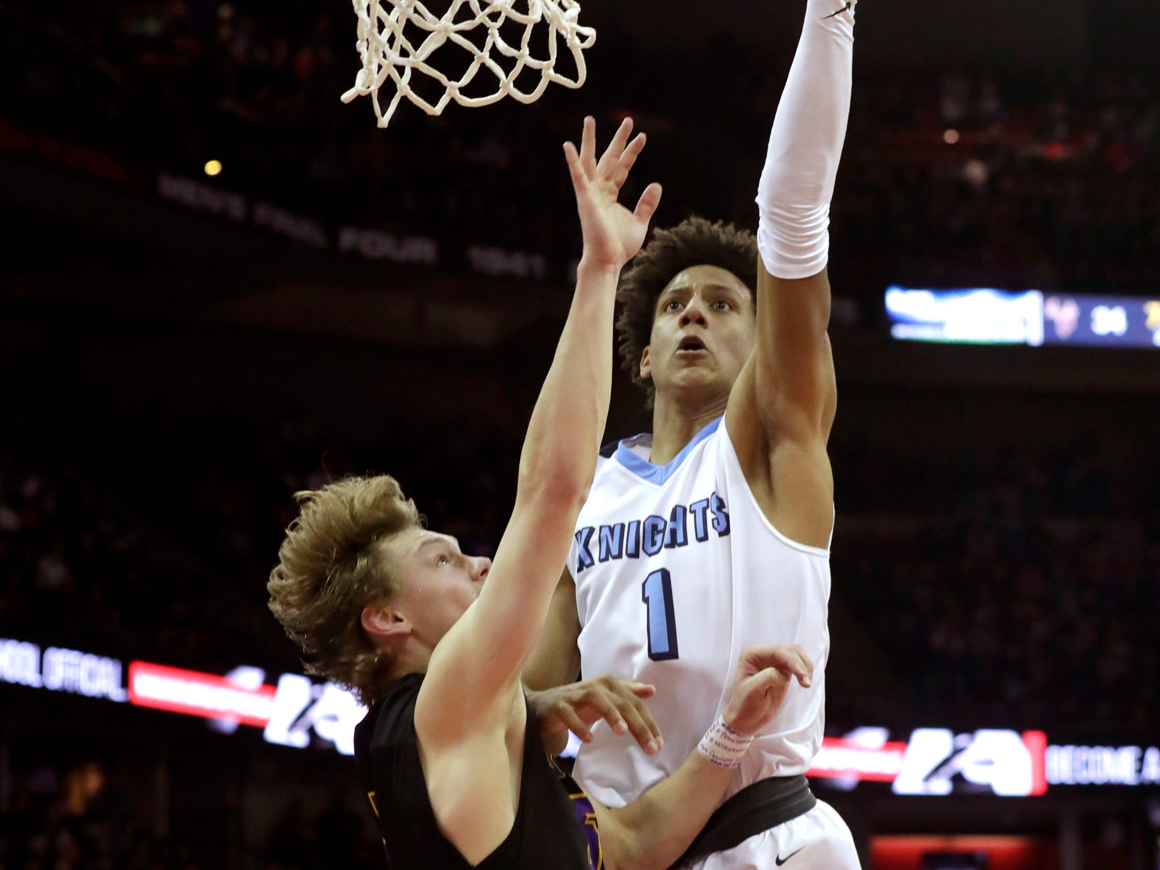 Nicolet's Jalen Johnson gets to the rim for two of his 16 points.