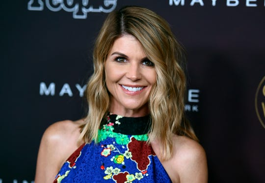 "In this Oct. 4, 2017 file photo, actress Lori Loughlin arrives at the 5th annual People Magazine ""Ones To Watch"" party in Los Angeles."
