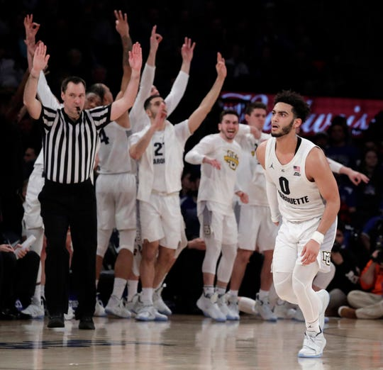 Marquette guard Markus Howard (right) looks on as teammates celebrate after he scored a basket against St. John's in the Big East quarterfinals Thursday night.