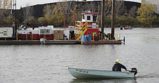Crews dredging contaminated sediments in the Fox River in Green Bay.