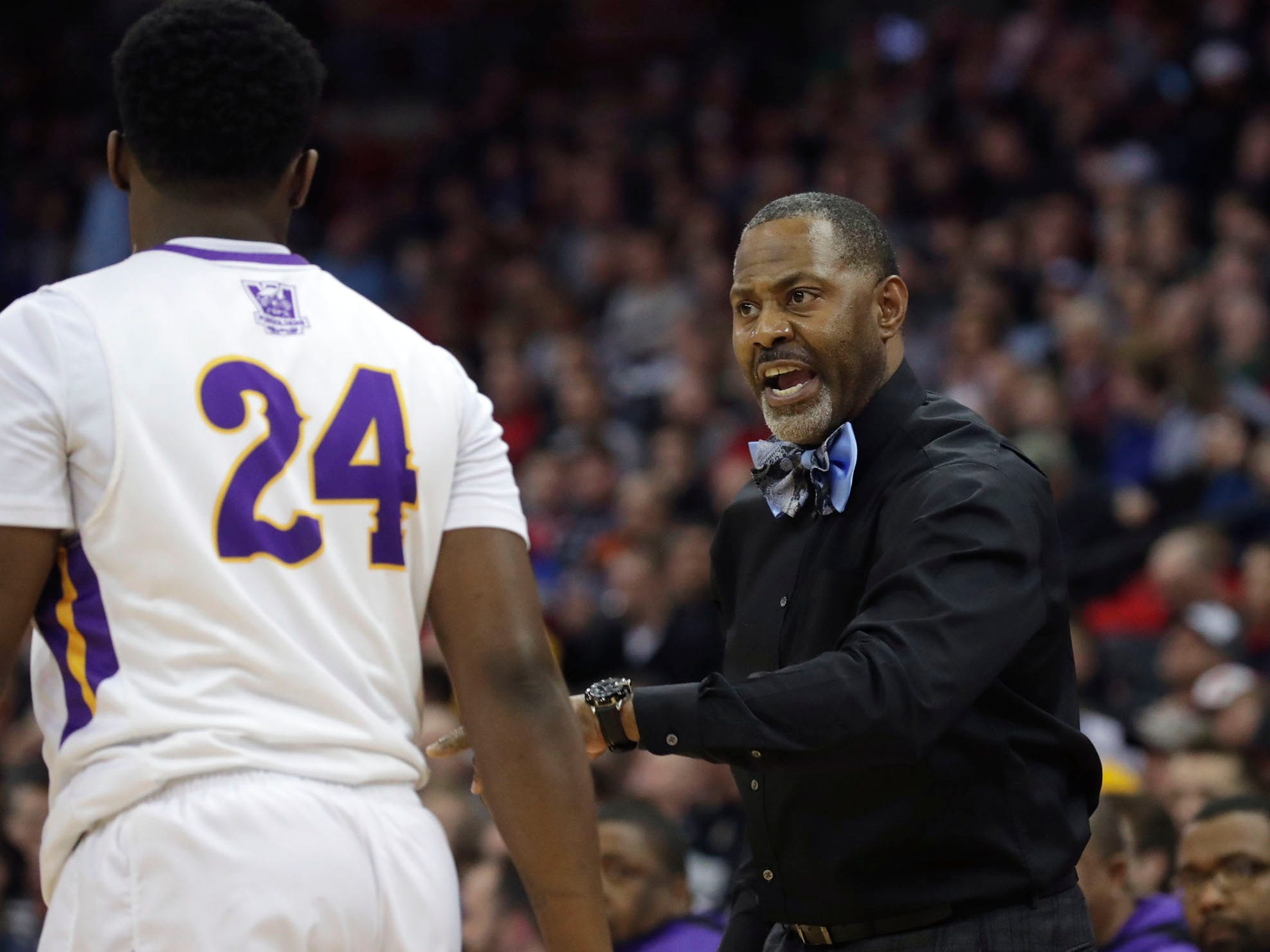 Milwaukee Washington coach Fred Riley talks with Remon Blakely during a the WIAA Division 2 semifinal game Friday afternoon.