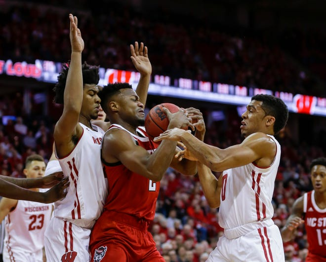 Aleem Ford (left) and D'Mitrik Trice of the Badgers each spent a year at IMG Academy, where Mark Riddell, who faces two criminal counts in the college entrance exam bribery scam, was the director of college entrance exam preparation at the Florida school.