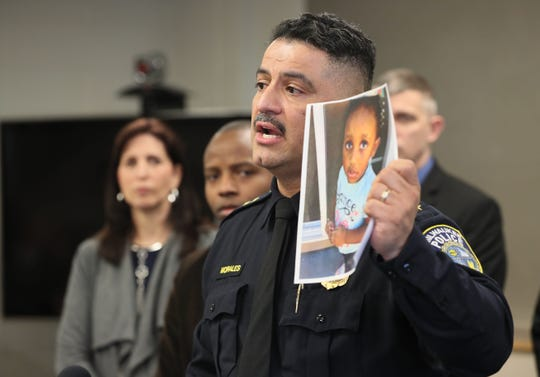Milwaukee Police Chief Alfonso Morales holds a photo of 2-year-old Noelani Robinson as he speaks at a noon press conference at the Police Administration Building.