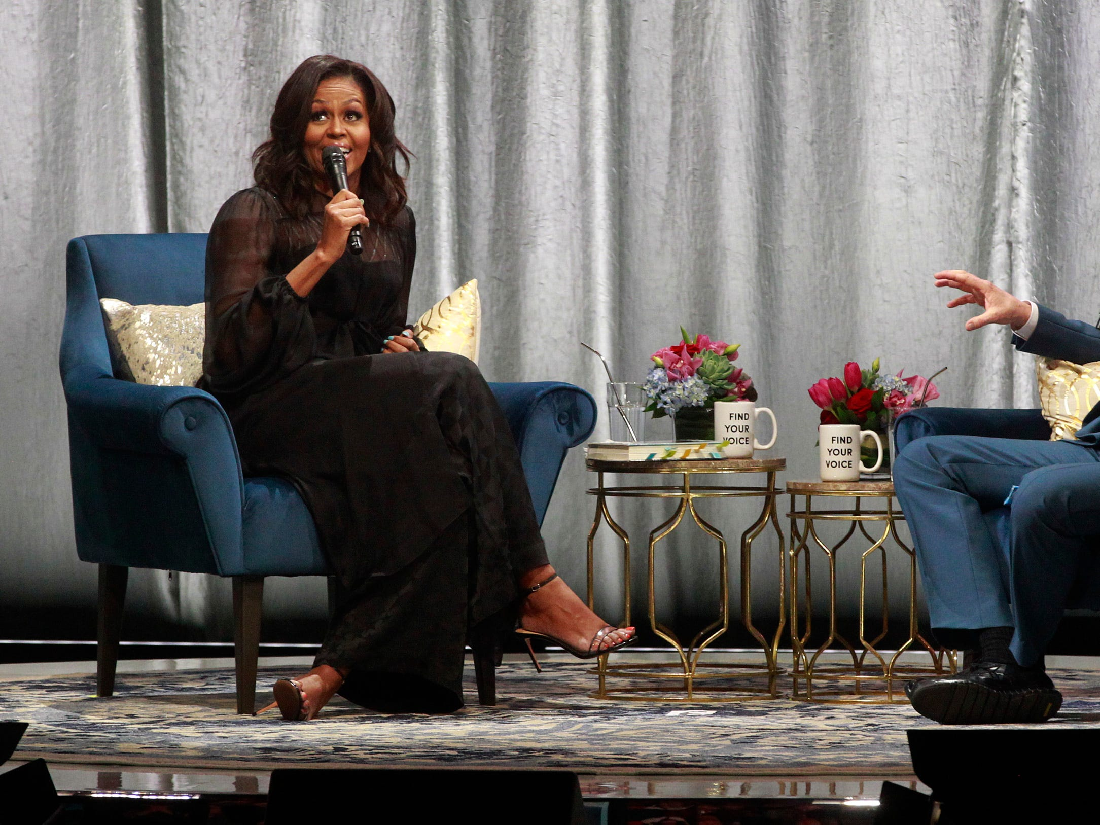 "Former first lady Michelle Obama and Conan O'Brien talk during her Milwaukee book tour,  ""Becoming: A Conversation with Michelle Obama""  at the Miller High Life Theatre."