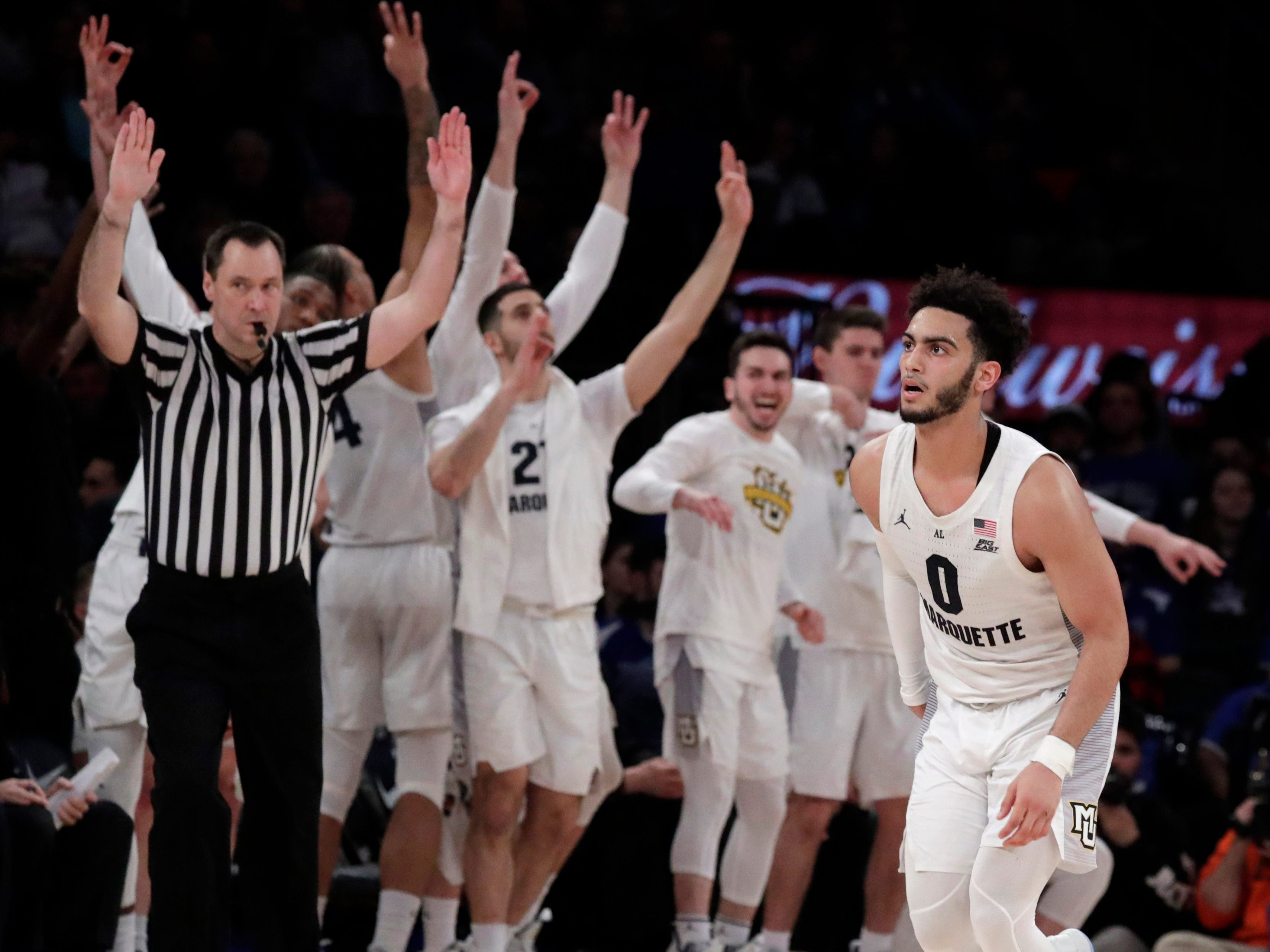 The Marquette bench celebrates after guard Markus Howard hits a three-point shot in the Big East quarterfinals Thursday night.