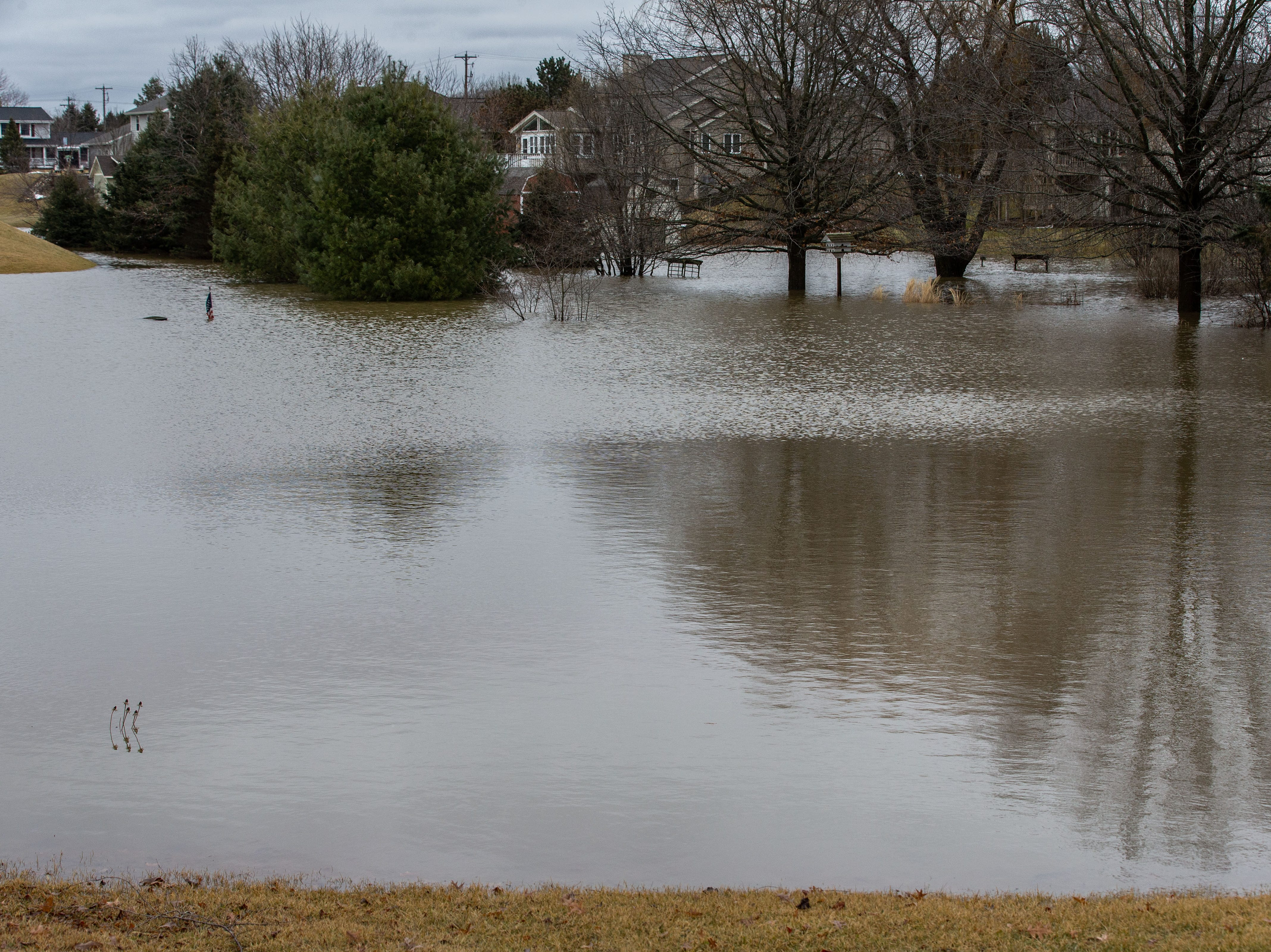 Flood water spills into the front yard of a home on Sweetbriar Lane in the town of Lisbon on Friday, March 15, 2019. Spring-like temperatures caused flooding across both Washington and Waukesha counties.
