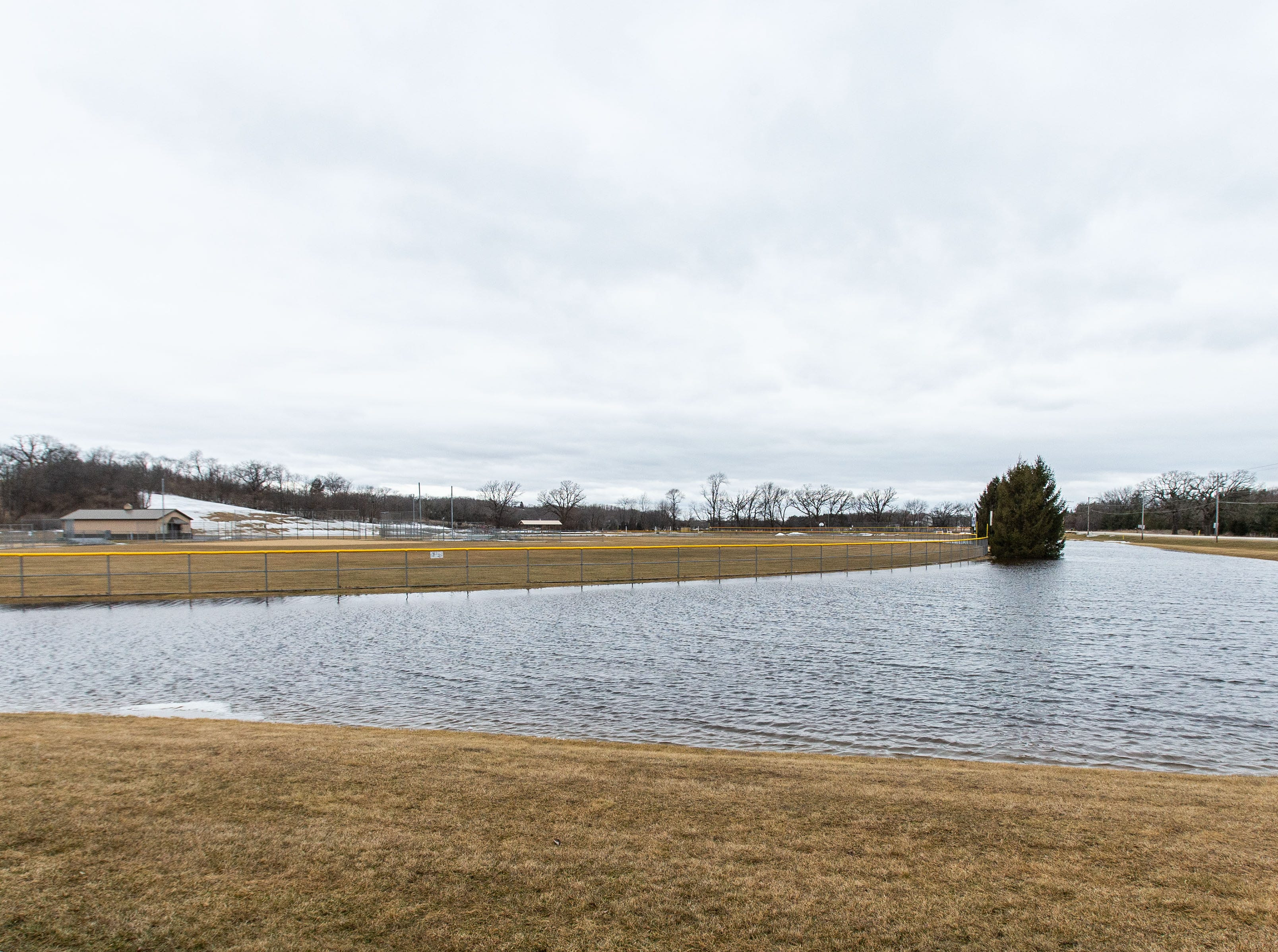 Flood water surrounds the athletic fields at Lauren Park in Mukwonago on Friday, March 15, 2019. Spring-like temperatures caused flooding across both Washington and Waukesha counties.