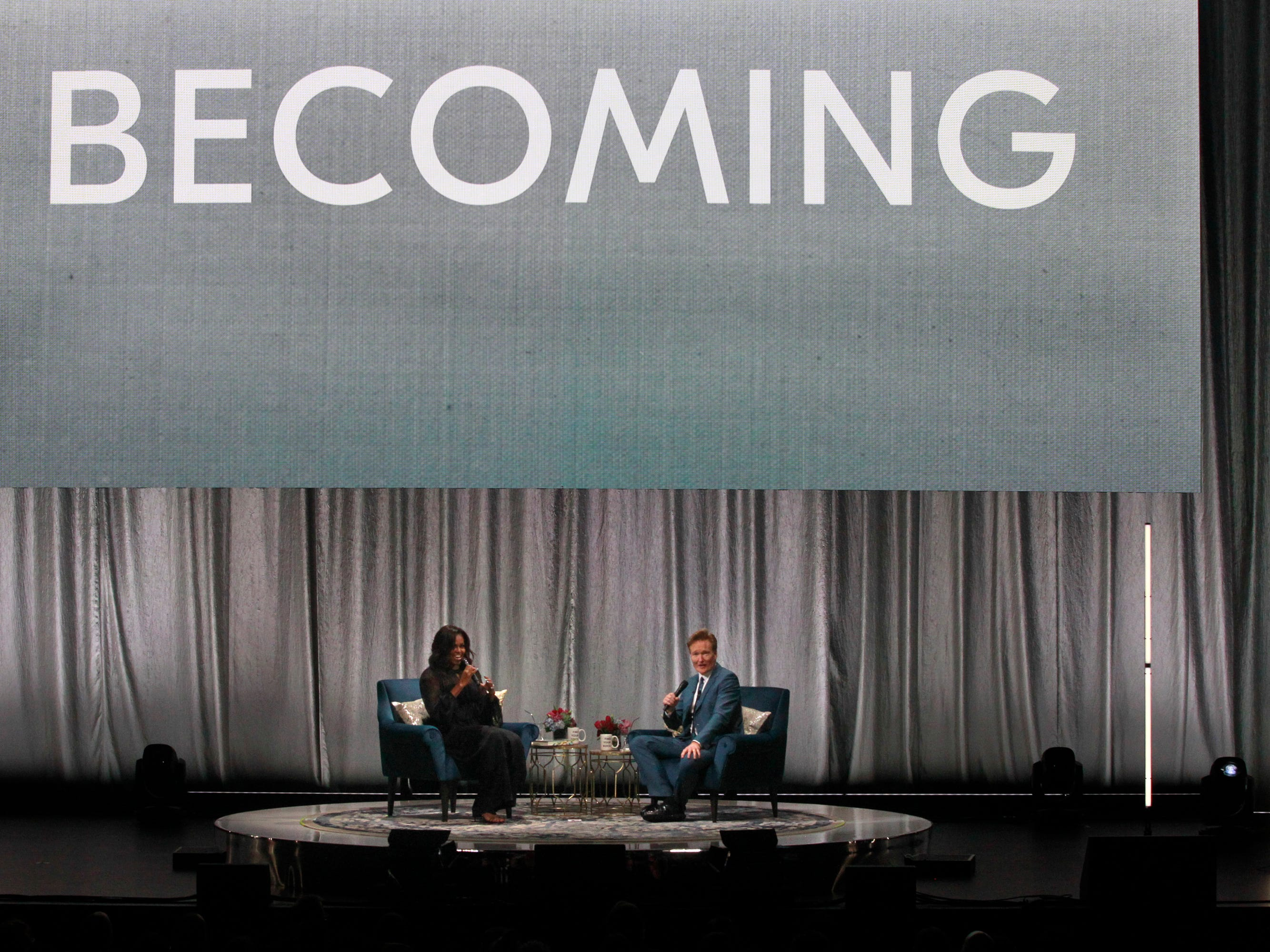 "Former first lady Michelle Obama and Conan O'Brien talk during her Milwaukee book tour, ""Becoming: A Conversation with Michelle Obama""  at the Miller High Life Theatre on Thursday. Comedian Conan O'Brien was the moderator for the event."