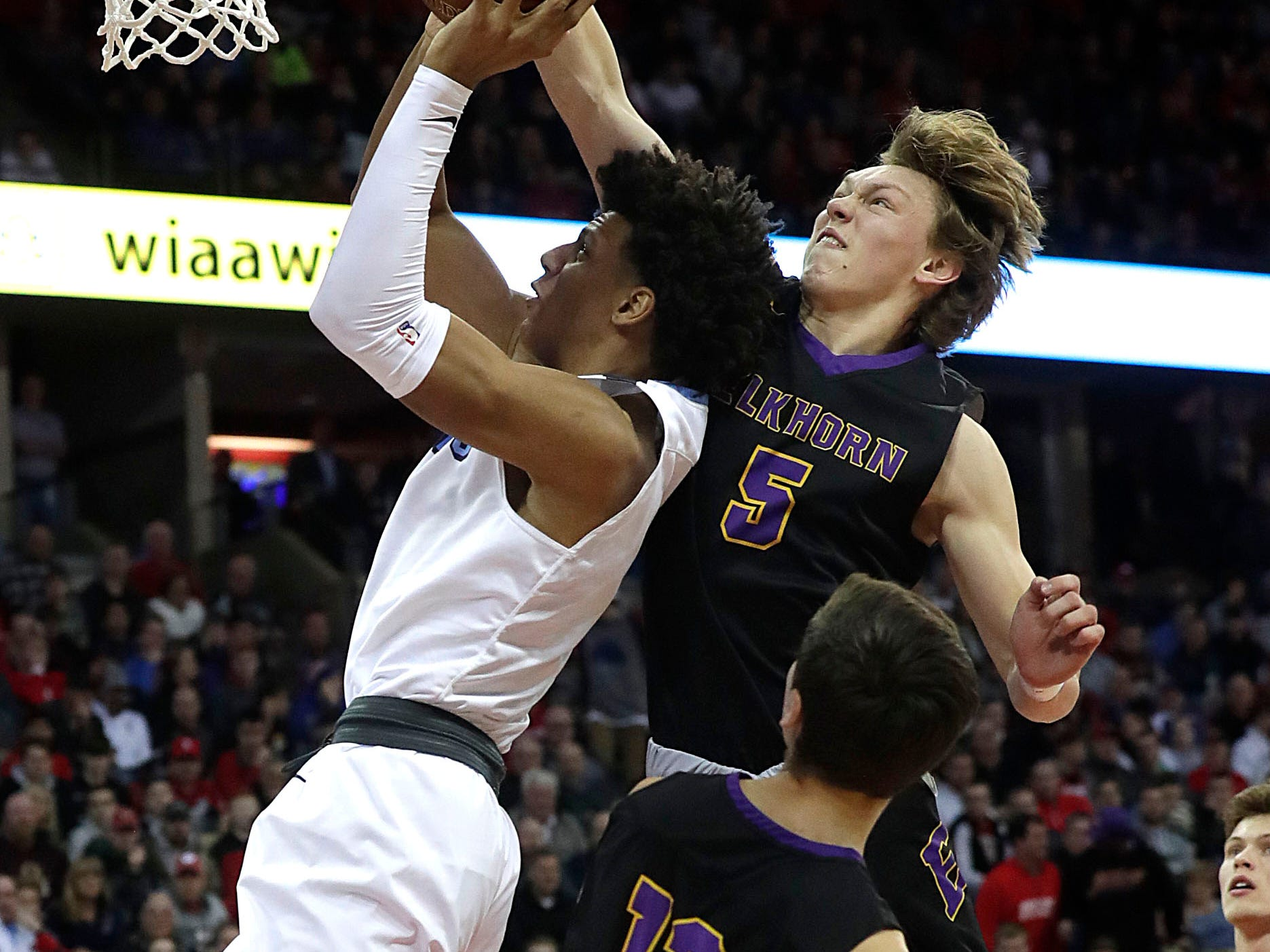Elkhorn's Chance Larson blocks the shot of Nicolet's Jalen Johnson's shot Friday afternoon in the Division 2 semifinals.
