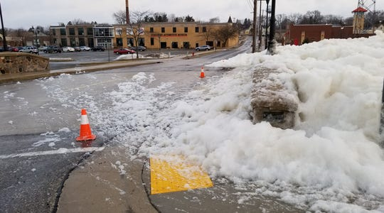 Foam is shown building up on the Rural Street bridge over the Rubicon River in Hartford this week.