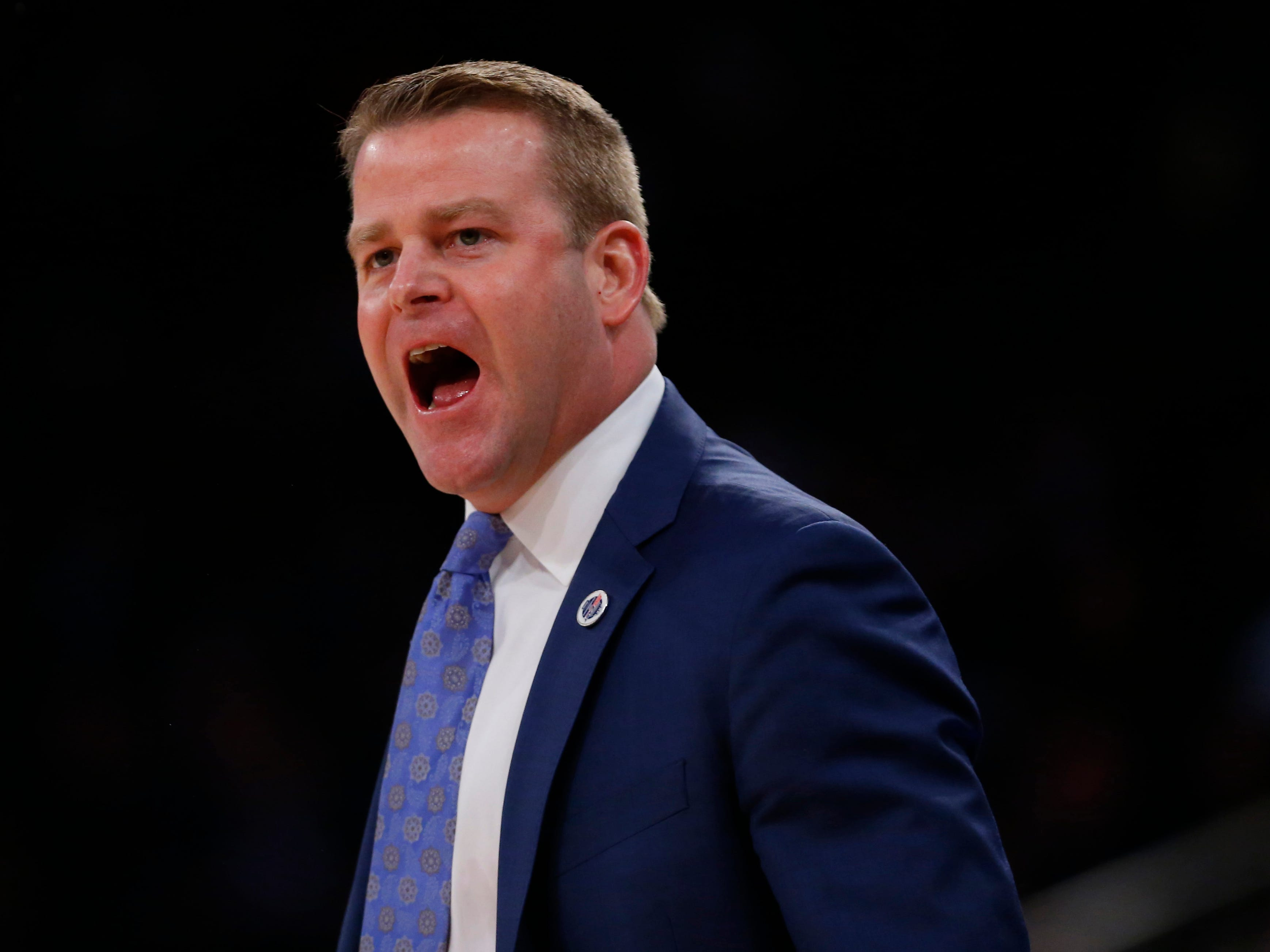 Marquette head coach Steve Wojciechowski appears unhappy with an official's call.