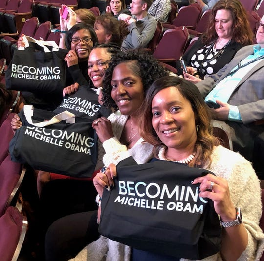 Michelle Nettles (left), Lynne LaGrant, Kimberly Walker and DeVona Wright Cottrell will leave Michelle Obama event with fond memories and souvenir totes.