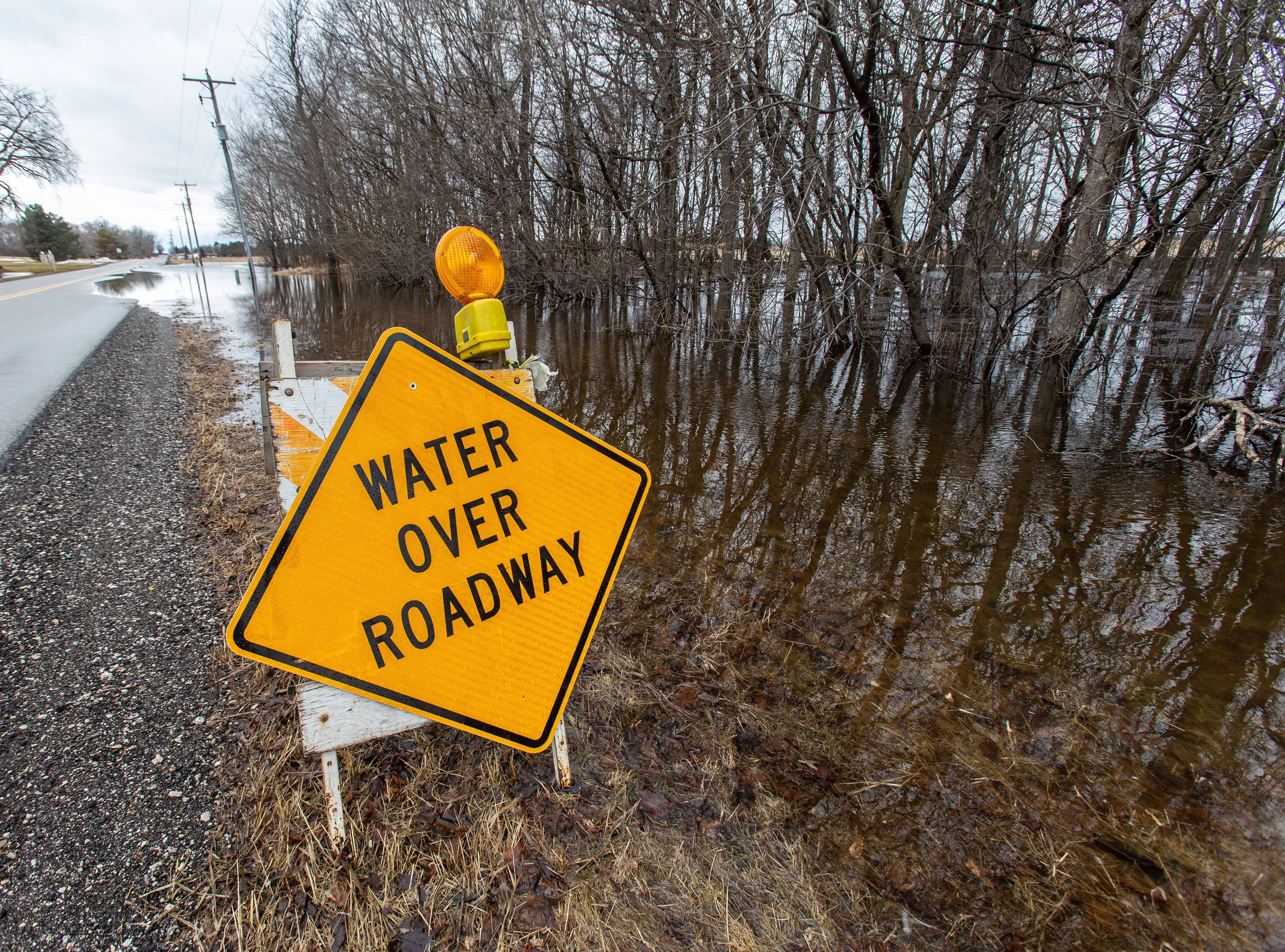 Flood water spills over Hickory Road in the town of Lisbon on Friday, March 15, 2019. Spring-like temperatures caused flooding across both Washington and Waukesha counties.
