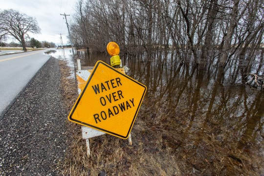 Flood water spills over Hickory Road in the town of Lisbon on Friday, March 15. Spring-like temperatures caused flooding across both Washington and Waukesha counties.