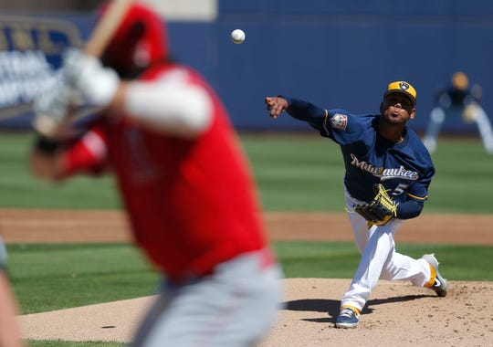 Brewers starting pitcher Freddy Peralta works in the first inning during a spring training game against the Los Angeles Angels at Maryvale Baseball Park.