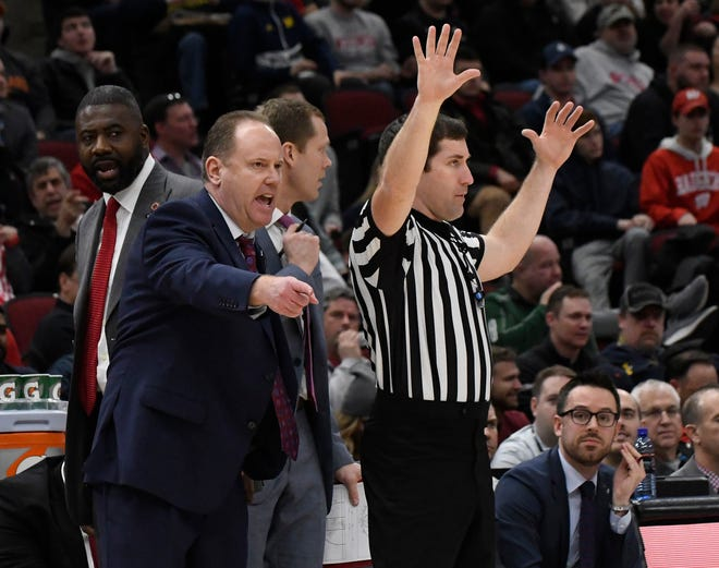 Wisconsin  head coach Greg Gard (left) questions a call during the second half.