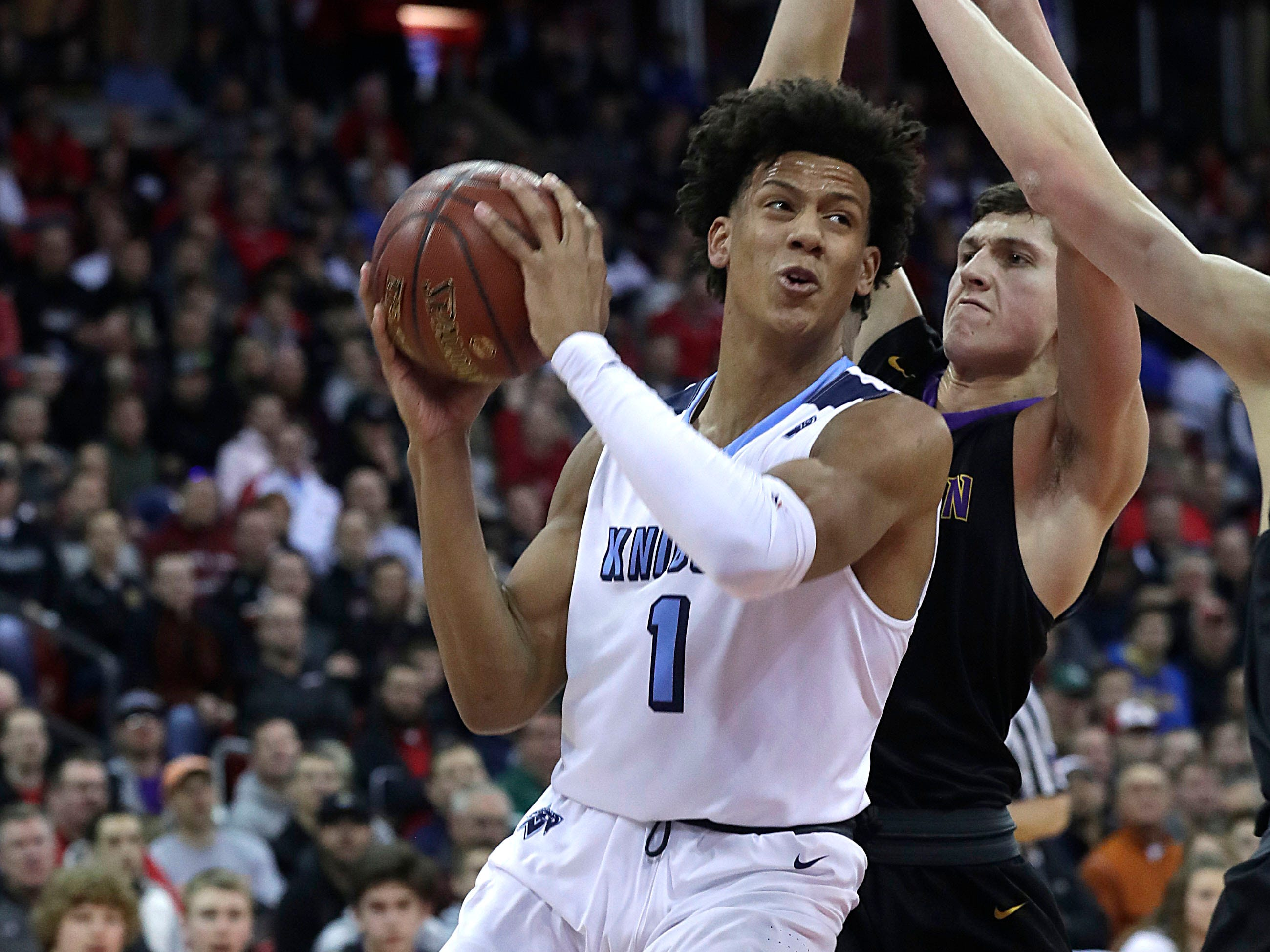 Nicolet's Jalen Johnson gets past defenders for a basket Friday in the Division 2 semifinals.