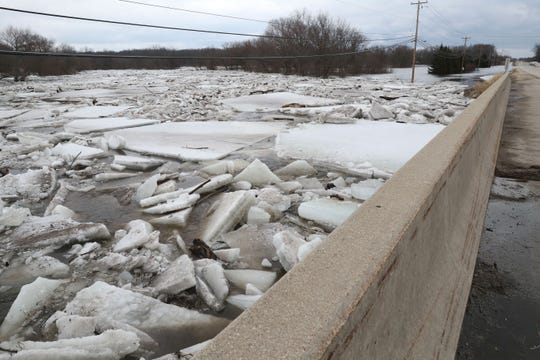 The view looking east along County Highway C. March 15, 2019 Grafton firefighters rescued two people from the Riverview Kennel on the Milwaukee River at  1584 Pioneer Rd in Cedarburg.  Ice going out on the river was blocked by bridge diverting flow over the Cty Highway C and the surround low areas.